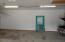 North 40' wall, baseboard on wood sheeting walls