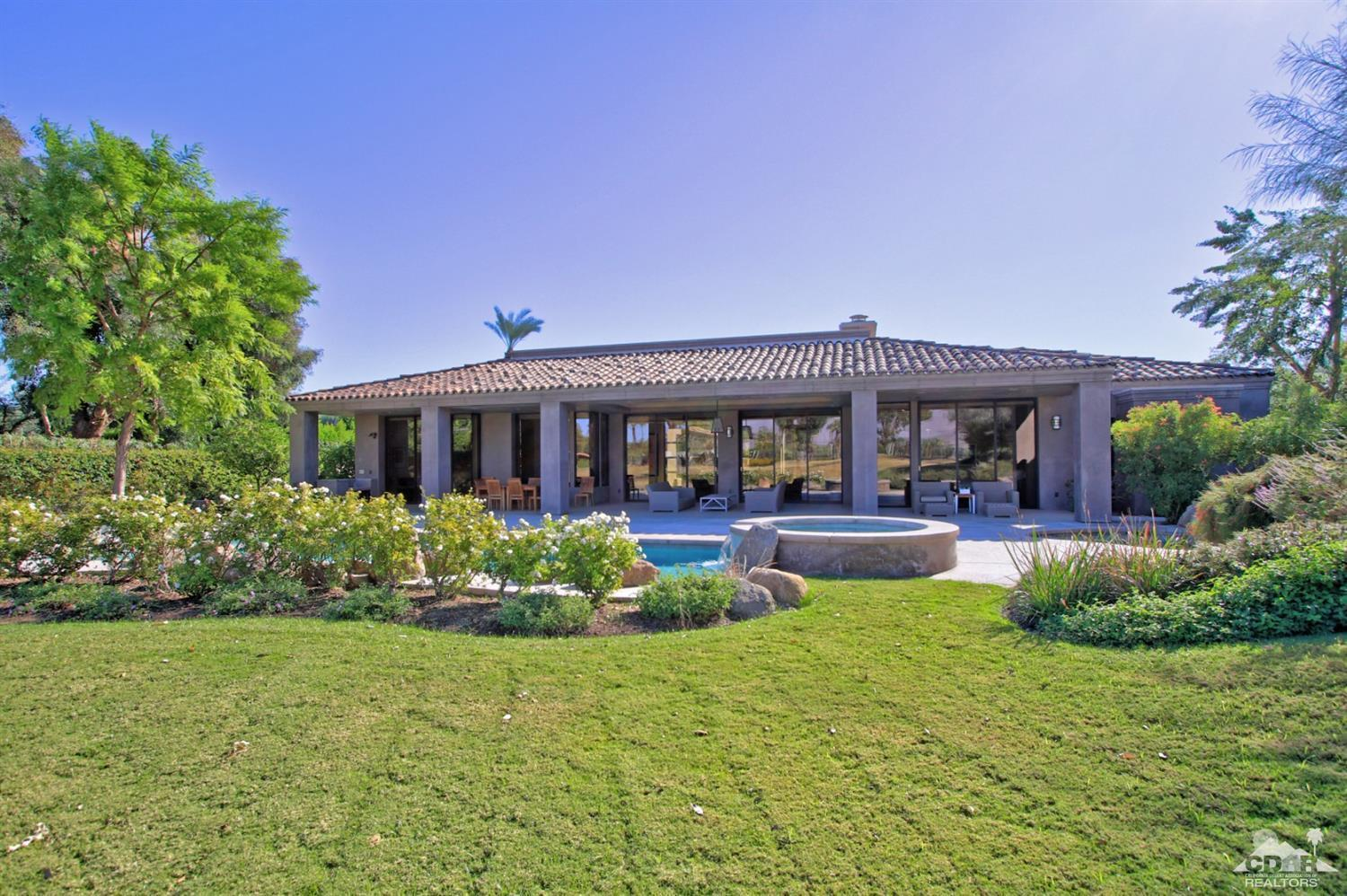 California contemporary custom built home by Stoker Construction. The finest finishing touches. West facing on the 14th fairway with mountain views on Tamarisk CC.Turn key furnished! No HOA