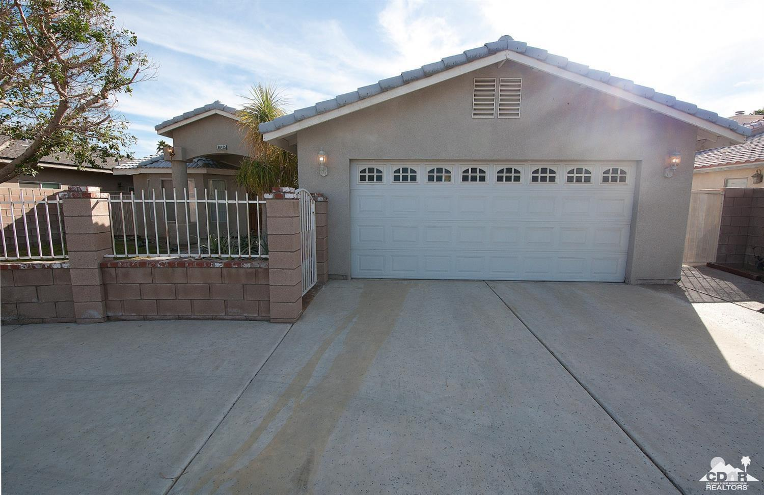 Come look at this spacious and perfect home for entertaining! Ample living room, and family room. Open Kitchen offers plenty of storage complete with breakfast bar that connects to the dining room. Pool size backyard and beautiful views of the desert mountains. 3 great rooms, and 2 baths and its own laundry room. Two car finished garage, and up to 4 car drive way. Move in ready! Located in Central Cathedral City close th Schools, shopping, and I-10 freeway!