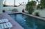 This home features a private pool, and desert low maintenance yard.