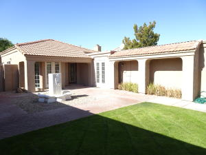 Front courtyard extended. Planter columns with lighting added. French door access added from kitchen and guest bedroom.