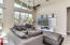 Living area with extra high ceilings and clearstory windows