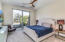 Ample master bedroom with direct access to pool area.
