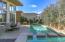 Spa cascades into swimming pool