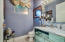Powder Room with Blue Brazilian Marble off Entertainment room