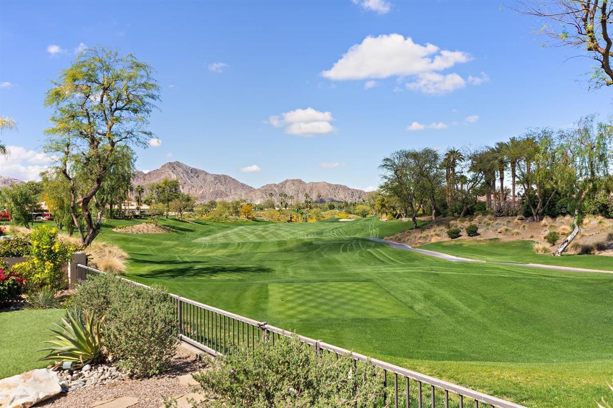 Welcome home to this updated, customized Encanto 1 with a detached casita in the gated community of Rancho La Quinta CC. Gorgeous, panoramic, western views from high above the 13th fairway of the Pate course are yours to enjoy with your friends & family. Take in the sunsets around the fire pit while enjoying the spa, or watch the golfers, pour a libation, fire up the grill, or relax on the beautiful, custom, desert landscaped, spacious patio. Inside, you'll enjoy the same breathtaking views from the open kitchen & great room. Unique features of this home include the casita, the high-end wood doors throughout, the stone patio, walkways & courtyard, extra-deep patio for the best of both worlds – sun & shade, fireplace surround, custom powder room, to mention just a few. The master suite & bath are impressive, as is the stunning master closet. With 2 guest rooms, that are just the right size, there's plenty of room, & an office to boot. HOA dues include front landscape maintenance, 9 pools & spas, high-speed internet, TV & phone, roving security, & trash. Your social membership includes the 6,500 sq ft Racquet Club & Fitness Center, 9 tennis courts, dining at the Club House & Cantina,