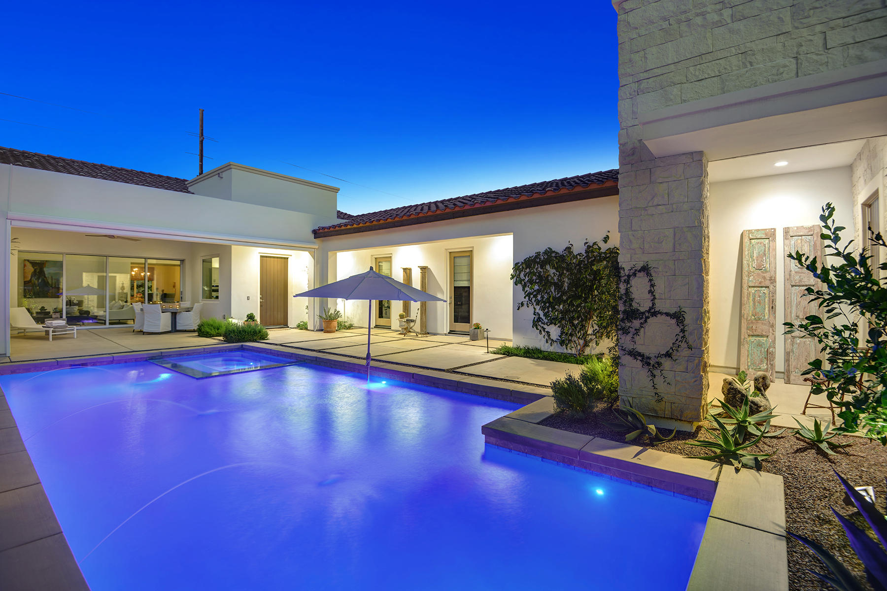 Built in 2018 and located behind the private gates at The Cove at The Citrus! This home offers everything you need to enjoy the desert lifestyle! The paver-stone driveway leads to the spacious private courtyard entrance with pool, spa, outdoor fireplace & large covered patio area overlooking the mountains that makes for great outdoor entertaining! Step inside to this open floor-plan with large tile flooring & vaulted ceilings. This Santa Barbara floor-plan offers a bright and open great room concept with pocketing doors that lead to the refreshing pool & spa! Culinary kitchen is a cooks dream with stainless appliances, walk in pantry, gas range, quartz counters, large island & soft white cabinetry! Master suite with large walk in closet, double vanities, soaking tub & walk in shower! Your family & friends will love the guest rooms with their own en-suites that offers great privacy! Great opportunity to move right into a home that is less then one year old!