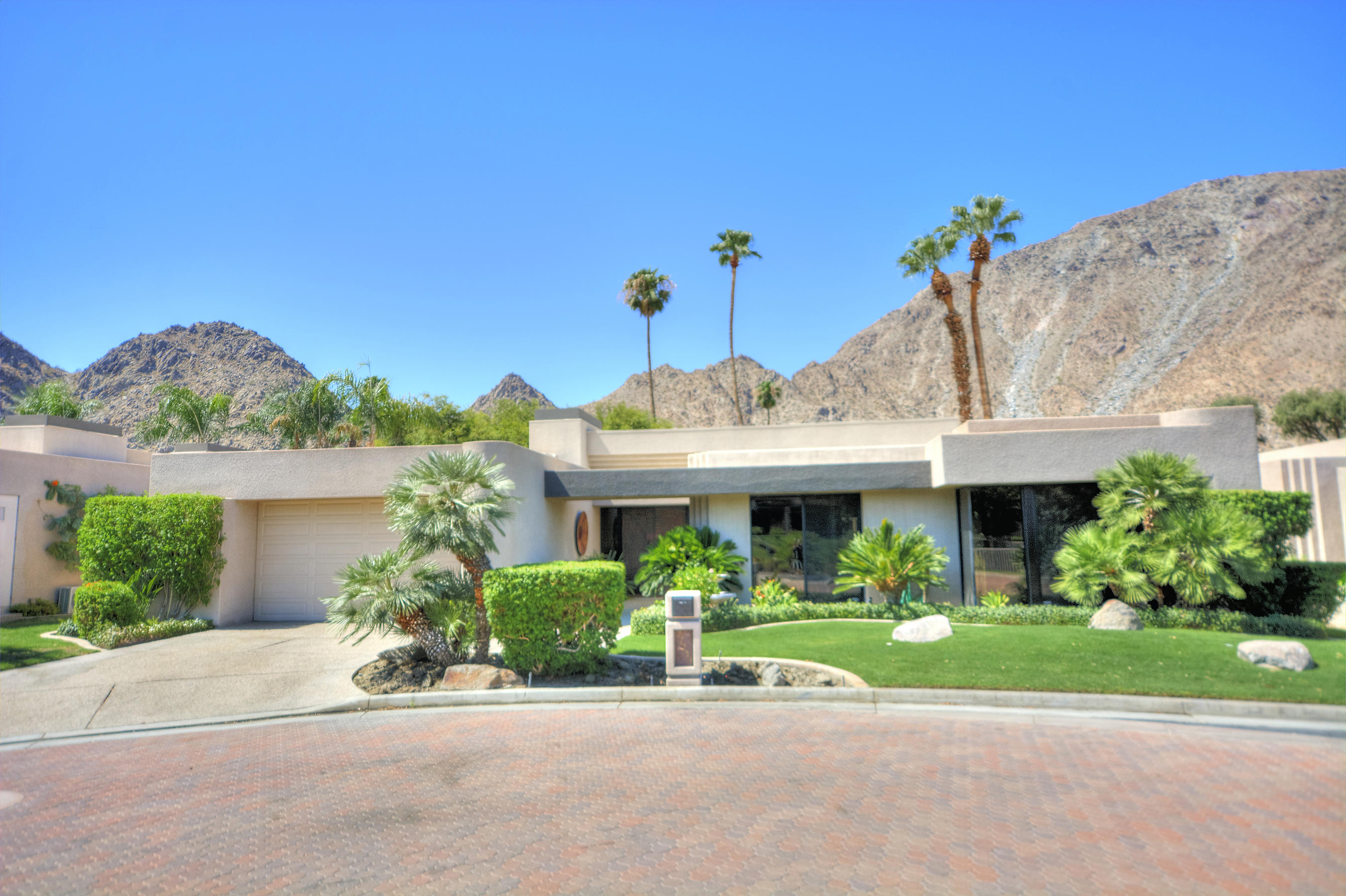 Idyllic location w/ south  panoramic mountain  views, 3739 Sq.Ft. 3 bed, 3 bath home overlooks 15th Fairway of IWCC Cove Course.  Enter guard gated Mountain Gate & arrive at private gated entry of Cove Pointe Community, luxurious enclave of 17 homes. HOA fees pay for beautiful community pool, spa & landscaping. Home is on quiet cul-de- sac, south facing & picturesque views w/ extended covered patio & built-in BBQ island for outstanding entertainment.  Dark porcelain tiled floors give illusion of hardwood floors & high ceilings throughout.  Grand Foyer entry to Great Room w/ fireplace and Formal Dining Room & look straight out, glass sliders & clerestory windows showcase the mountain views. King-sized Wet Bar with granite countertops, bar seating, lots of storage, wine cooler, bar refrigerator, ice maker, mirrored & glass shelves with incredible mountain views. Gourmet Kitchen & informal Dining area are spacious & include granite countertops, two sinks, large island & built-ins, bar seating, & large pantry. Private  Master Bedroom has  gorgeous views & marble fireplace. Master Bath w/marble counters, jet spa, dual vanities, and closets.  Guest Rooms have built-ins & walk in closets.
