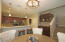 Dining area with upgraded lighting fixture.