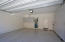 Attached two car garage with custom built-in cabinets and epoxy floors.