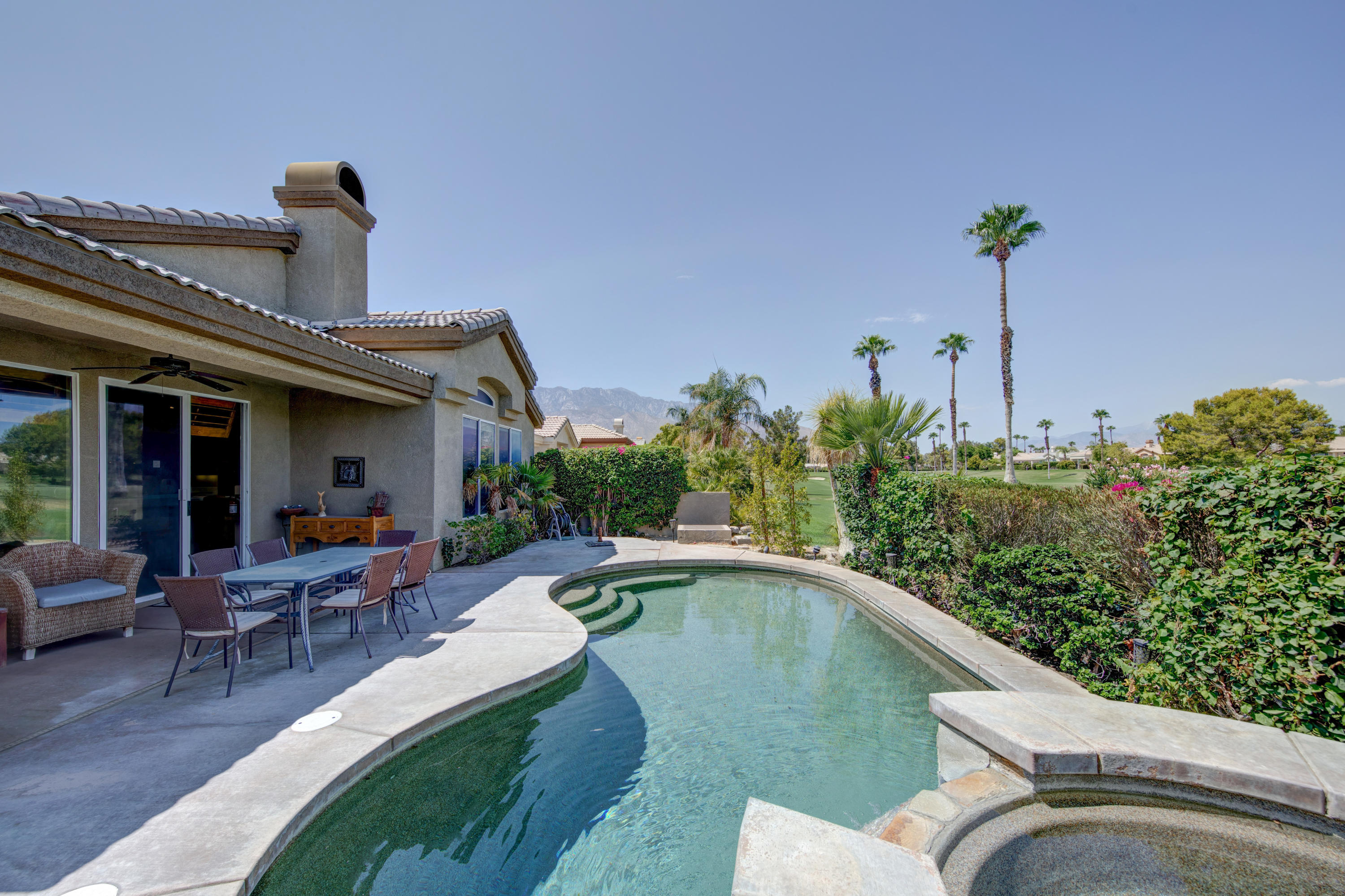 WOW!  Beautiful St. Andrews pool villa with Tommy Bahama flair!  Expansive views of Cielo 5 green and  San Gorgonio mountains.   Freshly painted kitchen cabinets.  This 2 bedroom with office/3rd bedroom is ideal for a work-at-home family.  Vacation in your own back yard with a fabulous pool with waterfall and spa.  New pool heater installed. Golf cart included! The Desert Princess has an affordable 27-hole PGA Championship golf course, no Tee-time lotteries, no initiation fees, rated among the best in the valley by GOLF DIGEST. This quiet community is away from the noise yet minutes from everything that is in Palm Springs; restaurants, shopping, casinos, an international airport, the Tramway, Art Museum, Theaters, and the Street Fair. Land Lease thru 2069, Monthly ground rent $119.58.