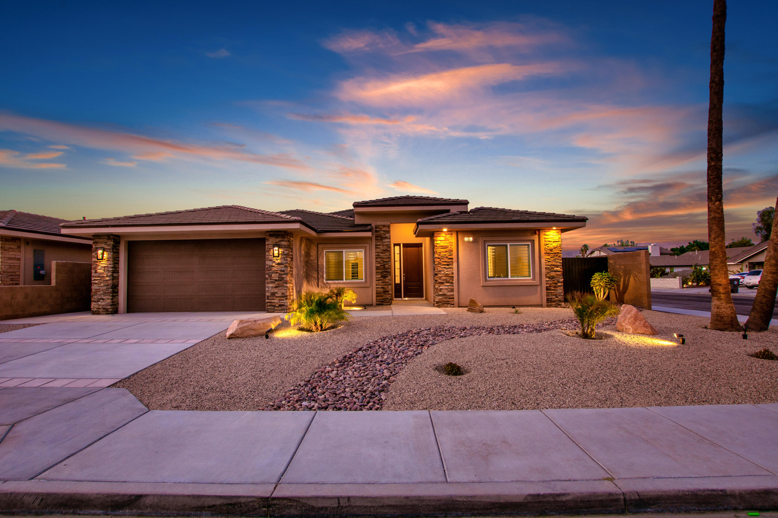 Your looking for a new Home? Look no more, this New Home has it all! 4 Bedrooms, 3 Baths, 2700 S.F., Pool & Spa with low maintenance front and back landscaping with lights. 2 Car Finished Garage (530sf garage, and insulated, 10 ft ceilings and 8 foot garage doors). Covered Patio (Over 200 SF), Block Wall Fencing with Rod iron gates on both sides. House is Extremely Energy Efficient (R 60 insulation in the ceilings, and R 27 on the walls, 2x6 Construction. Dual A/c units. 10 Foot Ceilings in the great room areas and 9 Foot ceilings in the bedrooms with ceiling fans throughout. Quartz Counter tops in Kitchen & Bathrooms. Upgraded Stainless Steel Appliances (Refrigerator, Stove, Dishwasher, Micro-Hood). Kitchen includes Pantry. Fans in each Bedroom, Great Room and Breakfast Nook. Recessed Lighting, Two-Tone Paint. Ceramic Tile throughout, built above Energy Efficiency Standards. This home has many other upgrades and incredible Mountain views, it's a must see! This is the picture of the model home, colors may vary.