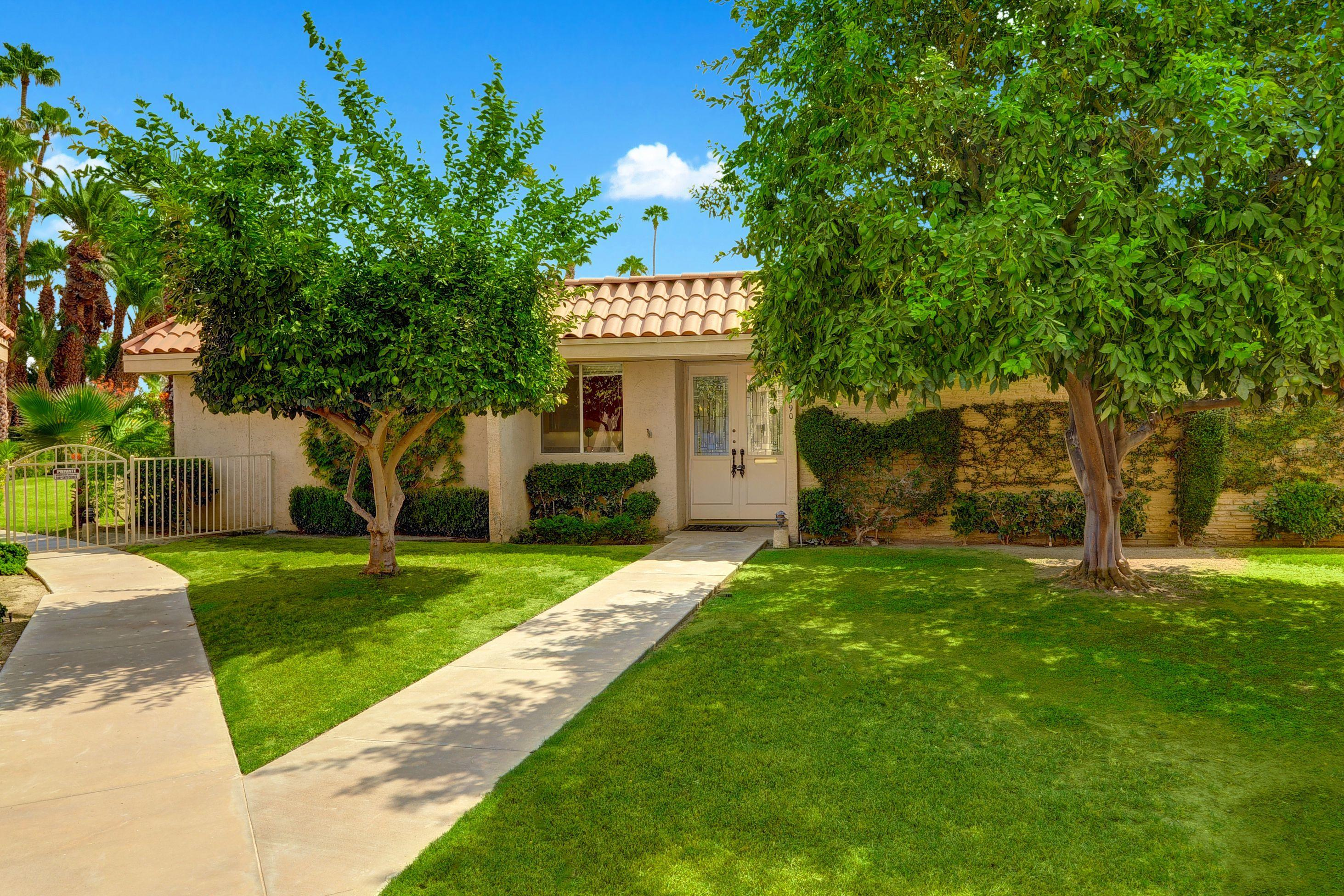 Welcome to this spacious one level floor plan condo in Indian Wells Country Club.  It features  an open and light living and dining room area with high ceilings. It opens up to the covered tile patio just steps to the community pool with amazing views. Kitchen has slab granite  counters with a garden view. 2 spacious bedrooms suites with walking closets, 2 baths. Main bath has dual vanities and a large shower.   Both suites enjoy gorgeous mountain views and  a direct access to their private enclosed courtyard  . Individual laundry room with extra space. It has a newer A/C and roof.