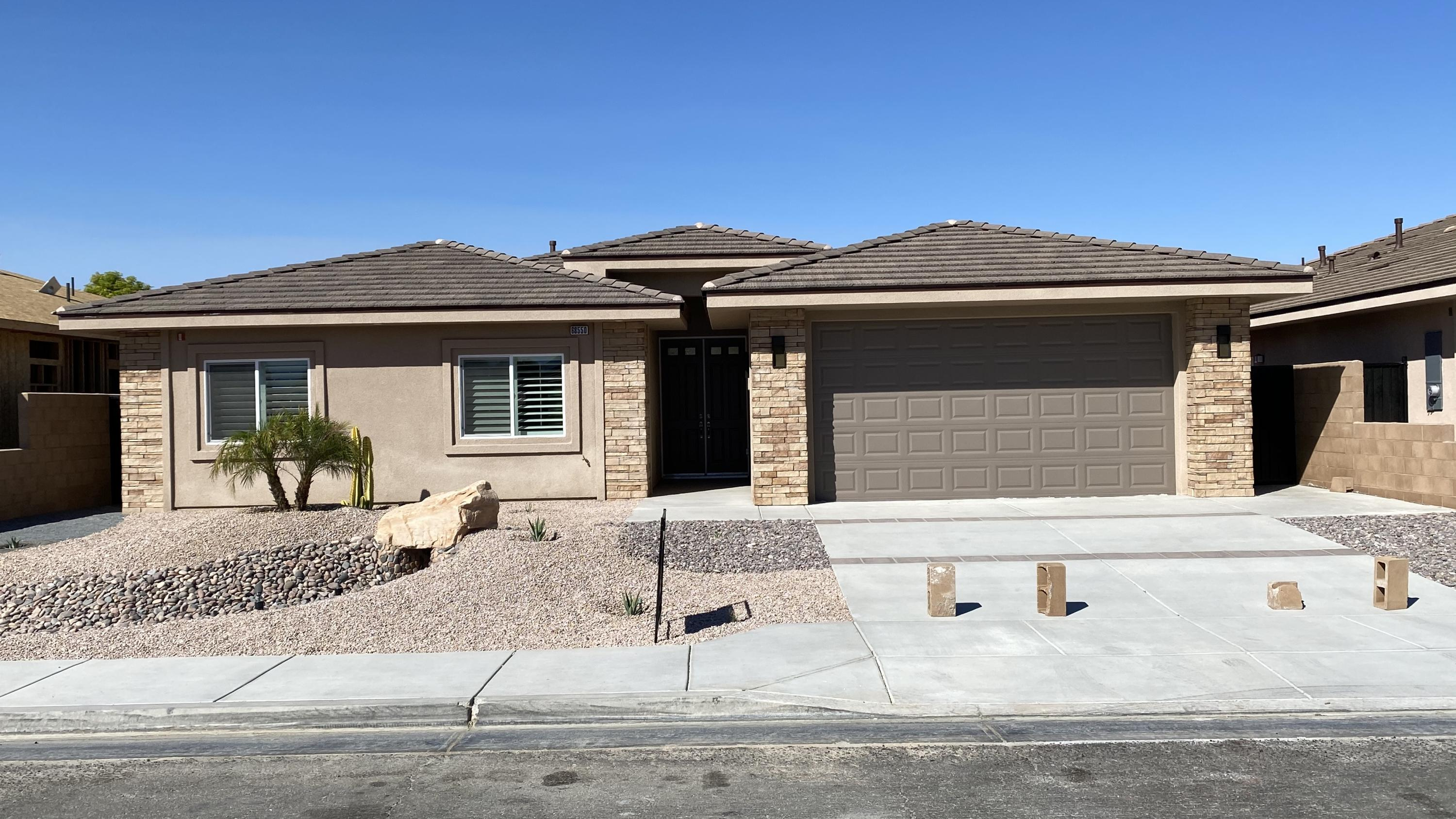 Your looking for a new Home? Look no more, this New Home has it all! 4 Bedrooms, 3 Baths, 2500 S.F., Pool & Spa with low maintenance front and back landscaping with lights. 2 Car Finished Garage (530sf garage, and insulated, 10 ft ceilings and 8 foot garage doors). Covered Patio (Over 200 SF), Block Wall Fencing with Rod iron gates on both sides. House is Extremely Energy Efficient (R 60 insulation in the ceilings, and R 27 on the walls, 2x6 Construction. Dual A/c units. 10 Foot Ceilings in the great room areas and 9 Foot ceilings in the bedrooms with ceiling fans throughout. Quartz Counter tops in Kitchen & Bathrooms. Upgraded Stainless Steel Appliances (Refrigerator, Stove, Dishwasher, Micro-Hood). Kitchen includes Pantry. Fans in each Bedroom, Great Room and Breakfast Nook. Recessed Lighting, Two-Tone Paint. Ceramic Tile throughout, built above Energy Efficiency Standards. This home has many other upgrades and incredible Mountain views, it's a must see! Model available to show, Call for completion date. Colors may vary.