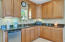 Guest house has kitchen with granite counters, custom cabinets, built in Refrigerator.