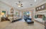 Master suite with sitting area and fireplace. Overlooks the covered patio and pool.
