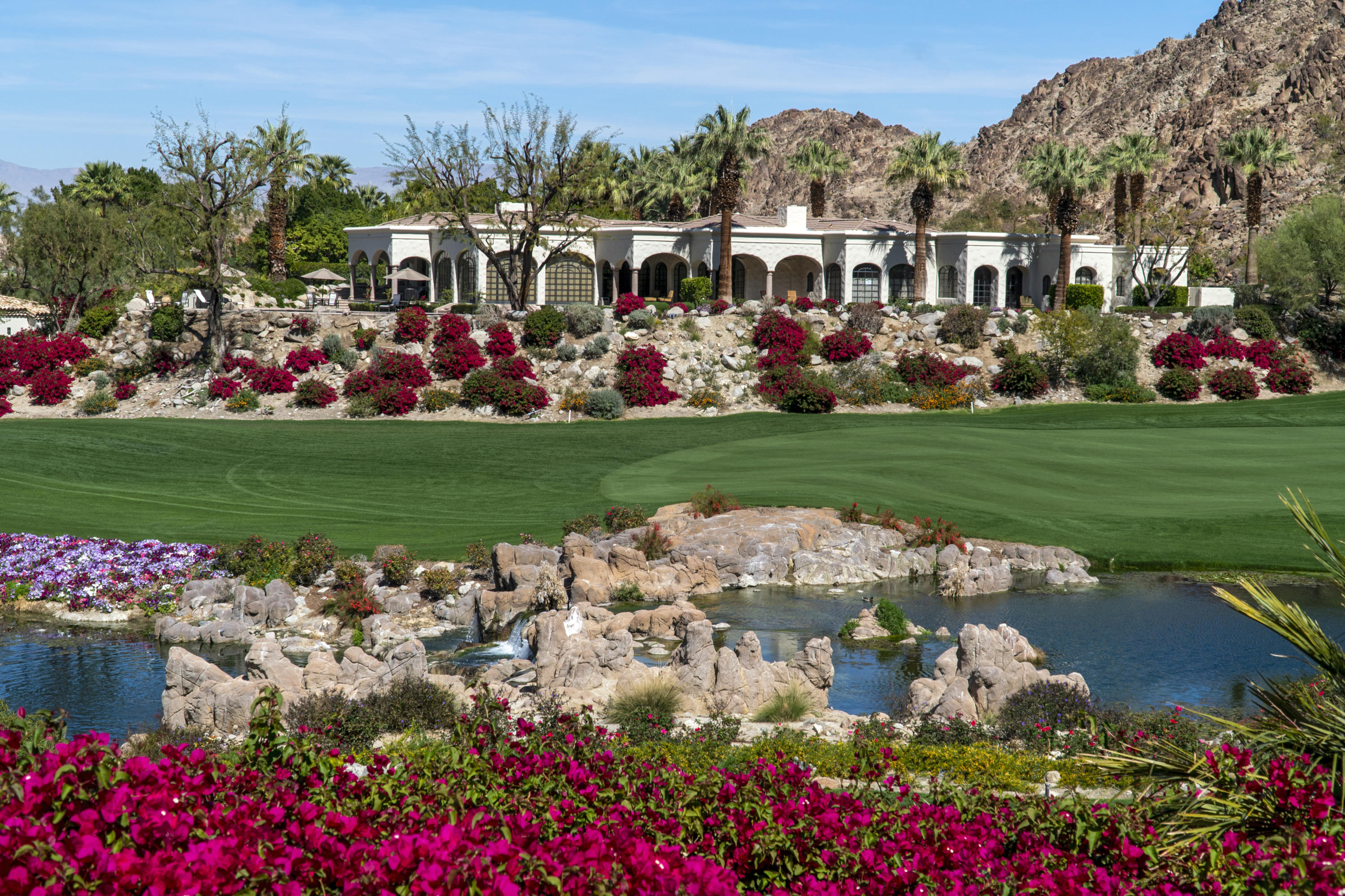 This home offers phenomenal elevated vistas of the Club's signature 16th Hole of the Mountain Course. An architectural masterpiece, by renowned architect Von M. White, with spacious interiors of approximately 9,461 SF. The home sits upon a private, elevated lot of nearly 23,958 SF overlooking multiple picturesque fairways featuring manicured bunkers, curving sand traps and meandering waterways with a rugged mountain backdrop. Located on the sunny side of the Cove, its location offers both poolside entertaining and the coveted sunset experience. Offered Furnished per Inventory.