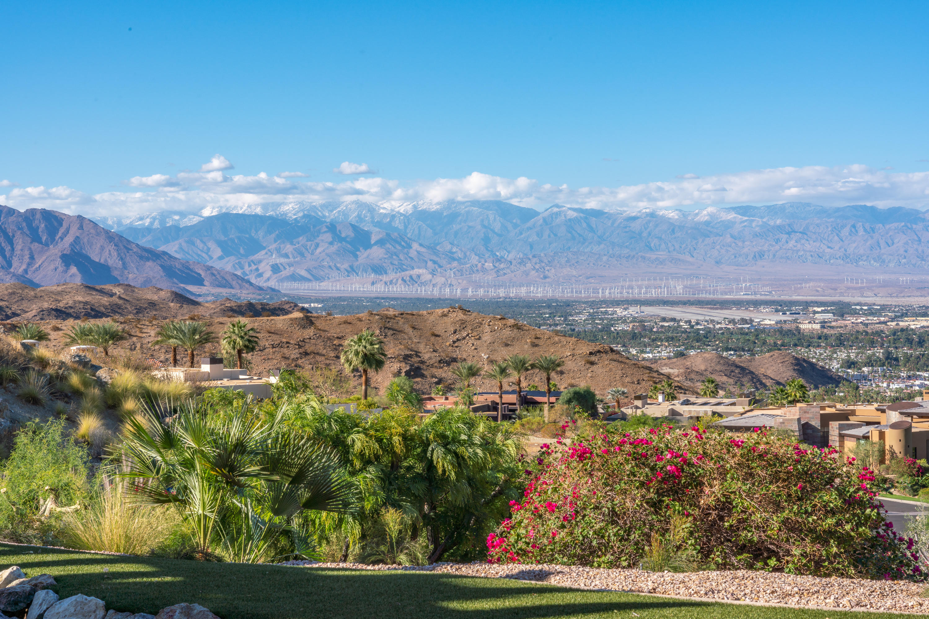 This incredible custom home offers dramatic down valley views, mountain views and ultimate privacy. Located on a corner lot in Mirada Estates, which is on the same hilltop as the world famous Ritz Carlton Hotel in Rancho Mirage. Built by respected developer Richard Pruter, PARR Development, offering the highest in quality construction, design & features. As you enter into the private courtyard, you will find a pool & spa enjoying the southern exposure & mountain views, offering the best in indoor/outdoor living. Once inside the home, massive disappearing walls of glass reveal covered outdoor living areas in both directions, with impressive down valley and mountain views across the Coachella Valley! The Grand Room features a fireplace and a sit down wet bar with a temperature controlled wine room. The gourmet kitchen includes a center island, top quality appliances, plus a butlers kitchen perfect for entertainment prep. The luxurious master suite offers views, a fireplace, his & hers baths & closets, a 2nd laundry and an exercise room. The Guest Casita is a suite with a sitting room and a kitchenette. A separate office with built-ins with double doors opening to the outside. There is a 3-car garage with air conditioning and plenty of storage space. This home is in perfect condition and move-in ready! Furnishings are included, with few exclusions. Homeowners enjoy amenities at the 5-Star Ritz Carlton Hotel.