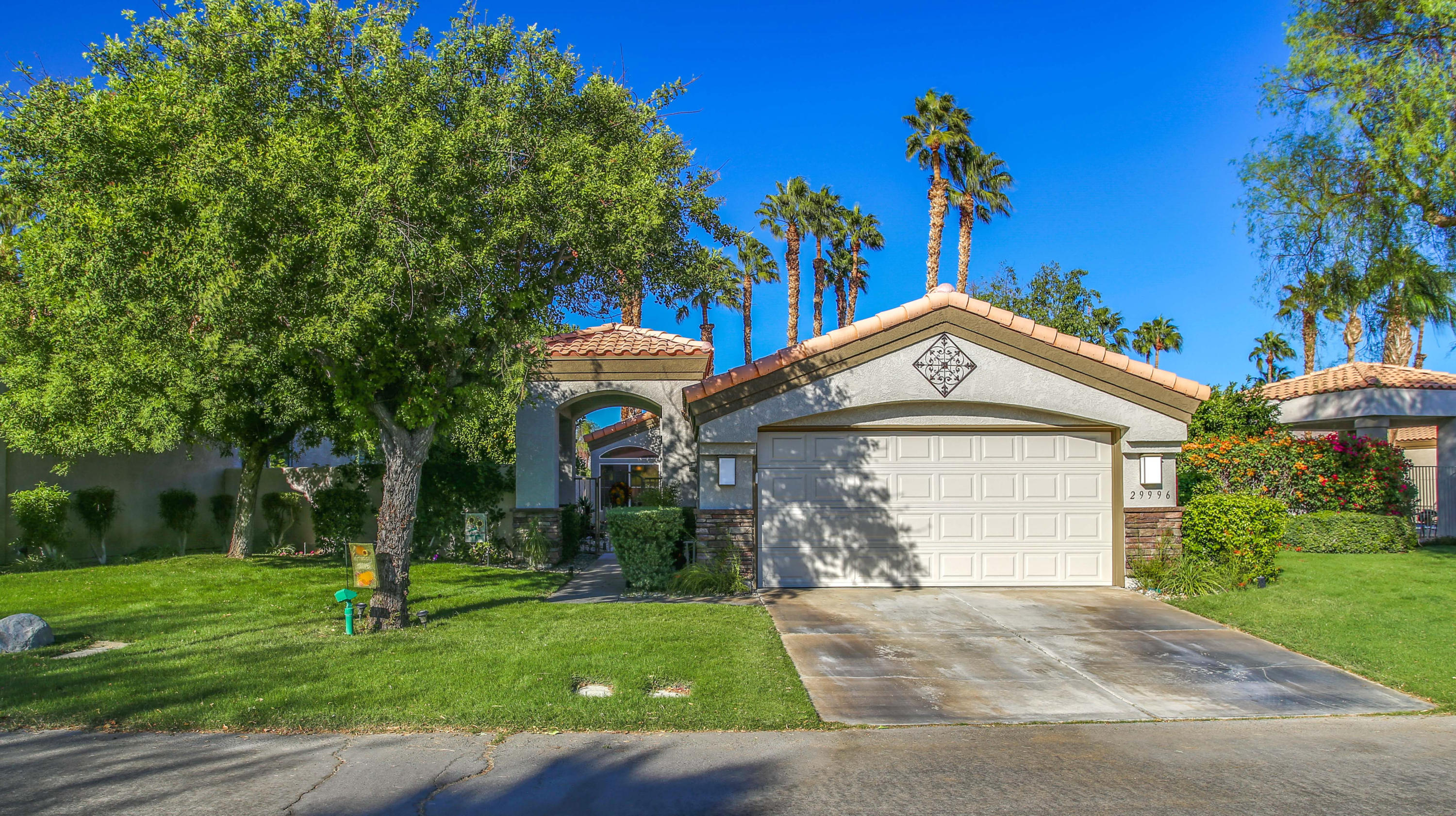 What a Gem, Completely updated, light and bright 2 bedroom villa is immaculate! Gorgeous views of the Golf course, Lakes, Chocolate Mountains.  Covered back patio with an extra large lot on the side. Offers a large master suite, Bright skylight and  you can walk right out to the Golf Course. Large tinted windows allowing you to enjoy the expansive views! Fire place! There is a formal dinning area as well as a separate office/den. Ceiling fans in every room, freshly painted, water heater installed 2019, New stainless steel appliances, Salt water purifier (owned), Reverse osmosis (owned) Custom landscaping... exterior painted in 2019. This home is being sold beautifully furnished. Home is equipped with Tesla solar at $206.17 per month for 15 years. The Desert Princess community has an affordable 27 hole PGA Championship golf course, This quiet community is away from the noise yet less than ten minutes from Palm Springs International Airport. Desert Princess has 34 swimming pools, 10 Tennis Courts, Health and Fitness Center. Land lease expires 2069, ground rent is $173.28 per month.