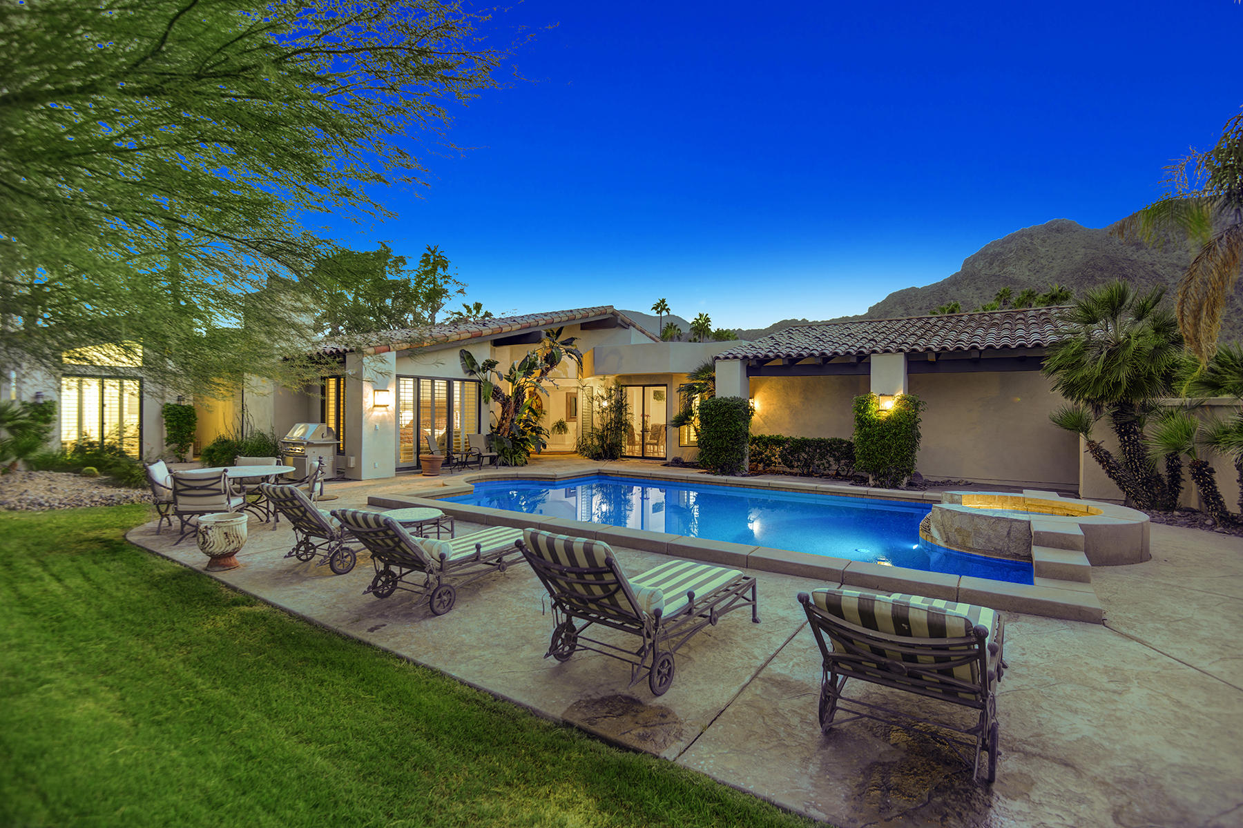 This gorgeous, former model home features unobstructed, south and west facing views of the spectacular Santa Rosa Mountains, and overlooks the 10th fairway and the 18th hole with lake views on the Arnold Palmer Private Course.  Situated on an oversized, premium lot, this home is in the most desirable location throughout all of PGA West and is sure to impress.  