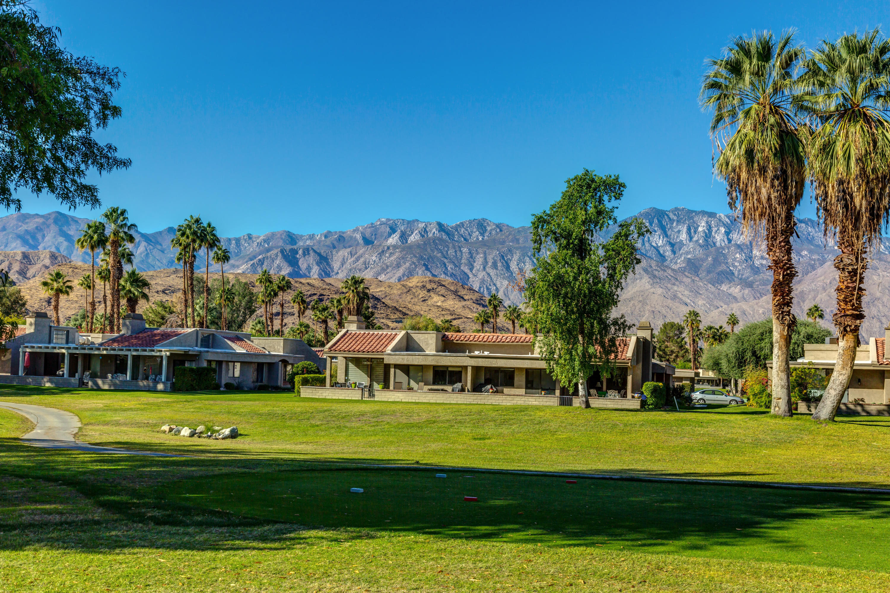 Views! Views! Views! Check out this 3-bedroom, 2-bathroom Golf Course Condo located inside Cathedral Canyon Country Club featuring an open floor plan, spacious bedrooms and majestic views of the fairway and surrounding mountain ranges.  This home features a light and bright living room with vaulted ceilings, clerestory windows, a mini wet-bar and fireplace with direct access to the private enclosed patio.  Formal Dining Area is just steps away from the kitchen and breakfast nook with direct access to the private patio and golf course views.  Master Bedroom features a large glass slider with West mountain views, mirrored glass sliders and en-suite master bathroom with dual sinks and stand up shower stall.  Bedroom 2 also has direct access to a private patio with an adjacent bathroom featuring shower and tub combo with dual sinks.  Bedroom 3 has large mirrored closet doors with easy access to the 2nd bathroom.  This beautiful Condo offers an added bonus space upon entry, indoor laundry room and direct access to the 2-car garage. Amenities at this community include a Public Golf Course, 10 Championship Tennis courts and Club House with Restaurant. Cathedral Canyon Country Club is centrally located to the Airport, Downtown Palm Springs Restaurants and world class Shopping, as well as Casinos and Entertainment.