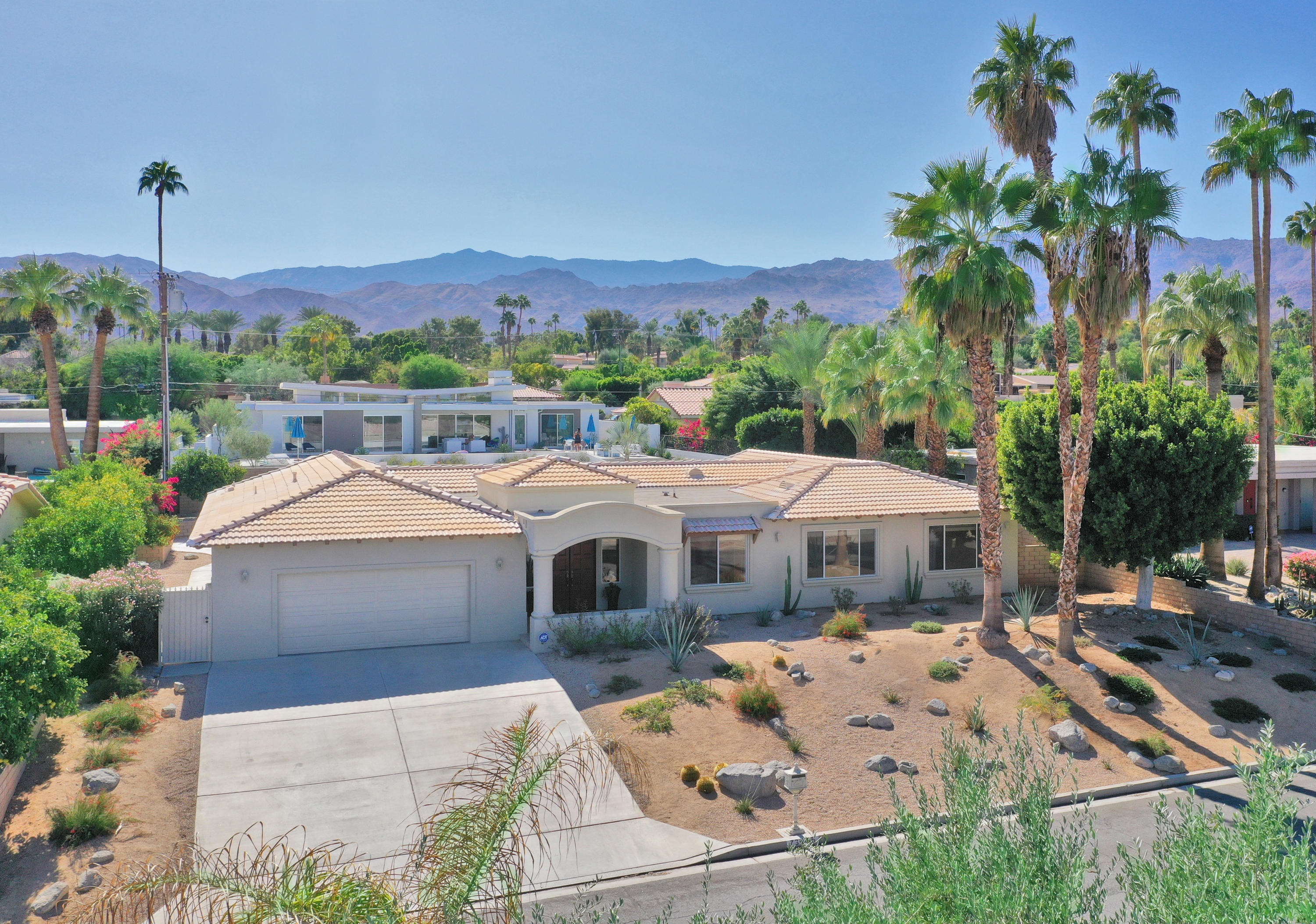 A wonderful South Palm Desert location, a short distance to the famous El Paseo Drive with many interesting shops and restaurants. This beautiful tiled roof, contemporary home has a large backyard with a beautiful in-ground, heated pool and spa. There is a small half bathroom, which is part of the main house close to pool/jacuzzi. The house has a large open floor plan, large entry with double front doors, formal dining room, large living room with gas fireplace and custom cabinets. There is a bright cheerful kitchen with center island, Corian countertops and walk-in pantry. The house has four bedrooms, each with its own private bath. The home has a double garage where the washer and dryer are located. Front yard has a low maintenance desert landscape. It's close to the Westfield Mall and College of the Desert.