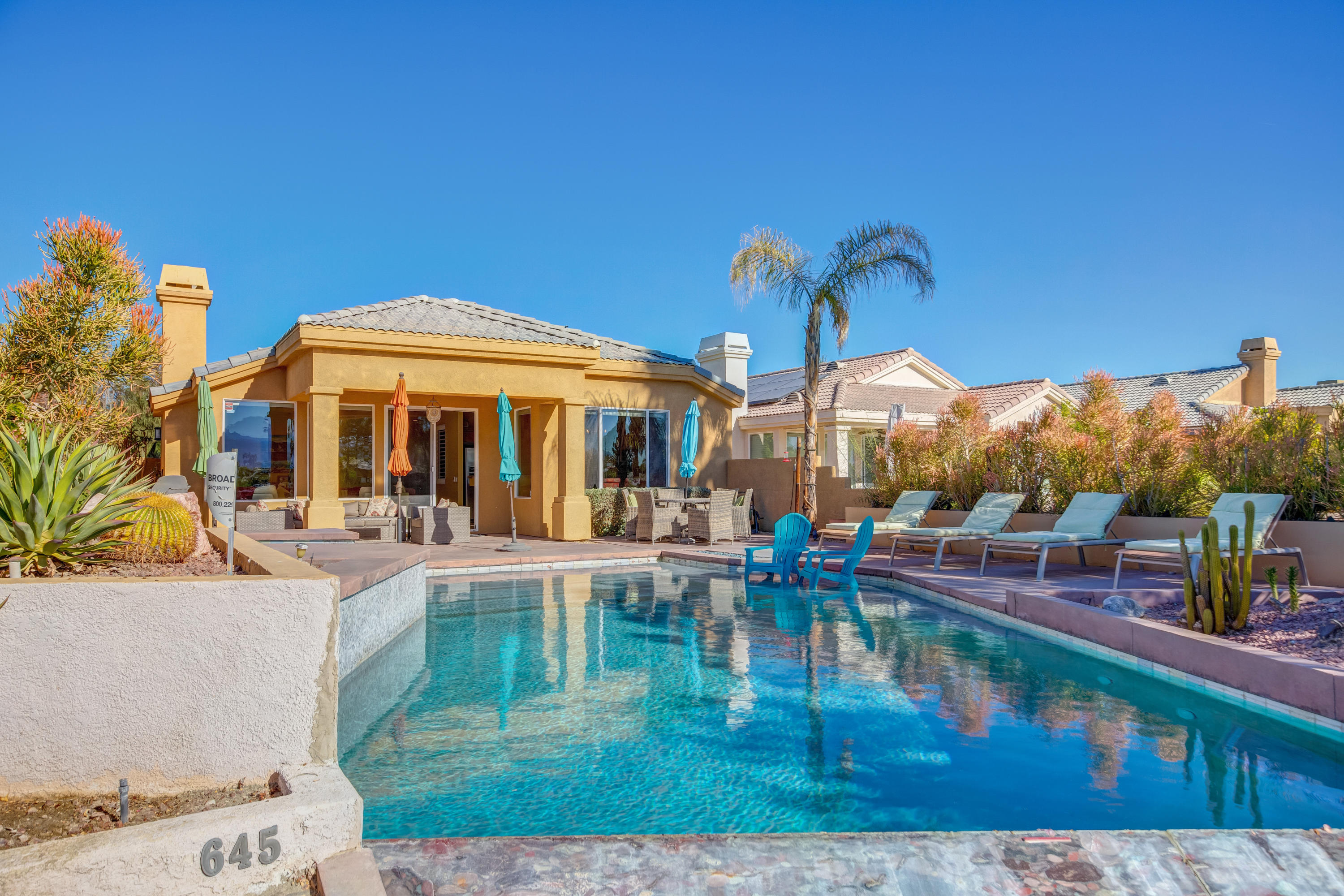 AMAZING INFINITY SALT WATER POOL WITH SPA.  This home is an entertainers dream.  Back patio has it all, South facing views of mountains and course, entertaining area with in ground fire pit.  The home boasts of slab granite countertops, Stainless Steel appliances, travertine stone floors AND remodeled master bath.  Bonus room for extra guests and den is made into a bedroom also.  Pool has new heater.  The Desert Princess community has an affordable 27 hole PGA Championship golf course, no tee time lotteries, no initiation fees, and is rated among the best in the valley by Golf Digest. This quiet community is away from the noise yet less than ten minutes from Palm Springs International Airport. Desert Princess has 34 swimming pools, 10 Tennis Courts, Health and Fitness Center.  Land Lease thru 2069, monthly ground rent is $105.13.