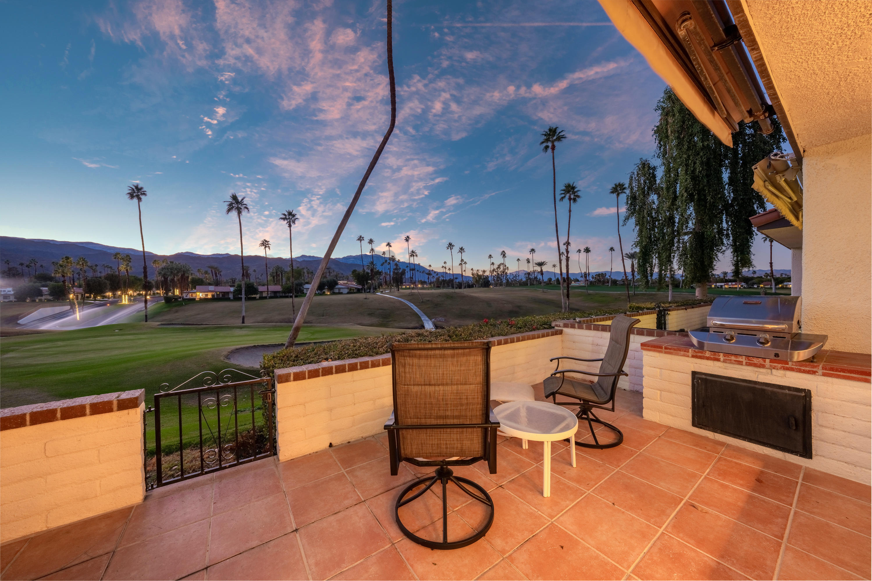 Breathtaking Mountain and Golf Course Views are enjoyed from this spacious condo in Rancho Las Palmas Country Club. There's plenty of room to relax and enjoy in this expanded 300 plan with 3 bedrooms, 2 bathrooms and 1800 square feet. A private gated entry courtyard leads to the front door on a tiled walkway while enjoying lush landscaping. Upon entering the home the Large sliding glass doors immediately let you enjoy the spectacular panoramic mountain views creating a picturesque scene. The home features an open great room with voluminous ceilings, a wet bar and tile flooring throughout provides easy living. The atrium has been converted to create a large, expanded kitchen and a spacious secondary bedroom. This home has been well maintained and includes dual zone heating & air plus a brand new epoxy on the 2-car garage floor. The rear patio will provide endless relaxation and enjoyment with motorized retractable awnings and a you can BBQ and dine while taking in the most ideal view. Rancho Las Palmas is located in Rancho Mirage with a convenient location near shops, restaurants and all the other desert amenities.