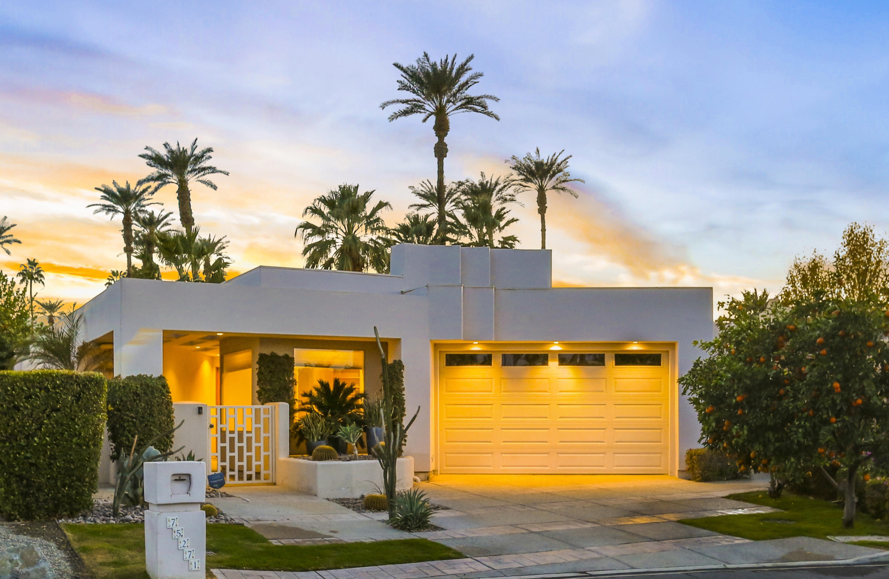 Stunning custom architectural beauty in a quiet area of one of the most sought-after neighborhoods in Indian Wells.  Nearly 3,500 square foot home, with 4 bedrooms + den/office and 3 baths.  You enter the expansive living room with soaring high ceilings which opens to the wet bar, and beyond is the kitchen and dining room.  Kitchen features stainless steel appliances, granite countertops and views overlooking the pool/backyard, and a large breakfast bar.   The living room features a multi-slide pocket door system to the pool patio, providing an indoor/outdoor experience, and a fully equipped wet bar near the kitchen.   Enjoy cocktails by your lap pool and spa, with a southwest facing view of the mountains from the beautifully landscaped backyard.  Master bedroom suite includes a fireplace, a huge walk-in closet, French doors to a secluded patio area, and an amazing bathroom with walk-in shower and separate soaking tub, also with views to the backyard and pool.  Guest bedrooms are carpeted, have high ceilings, and share a tiled bathroom with updated shower and granite countertops.  The office, located next to a full bathroom, has built-ins and a sitting area, but could easily be converted to a 4th bedroom.  This home also includes a full laundry room with lots of storage, and a 2-car garage.  This is a totally unique property which needs to be seen to be believed!