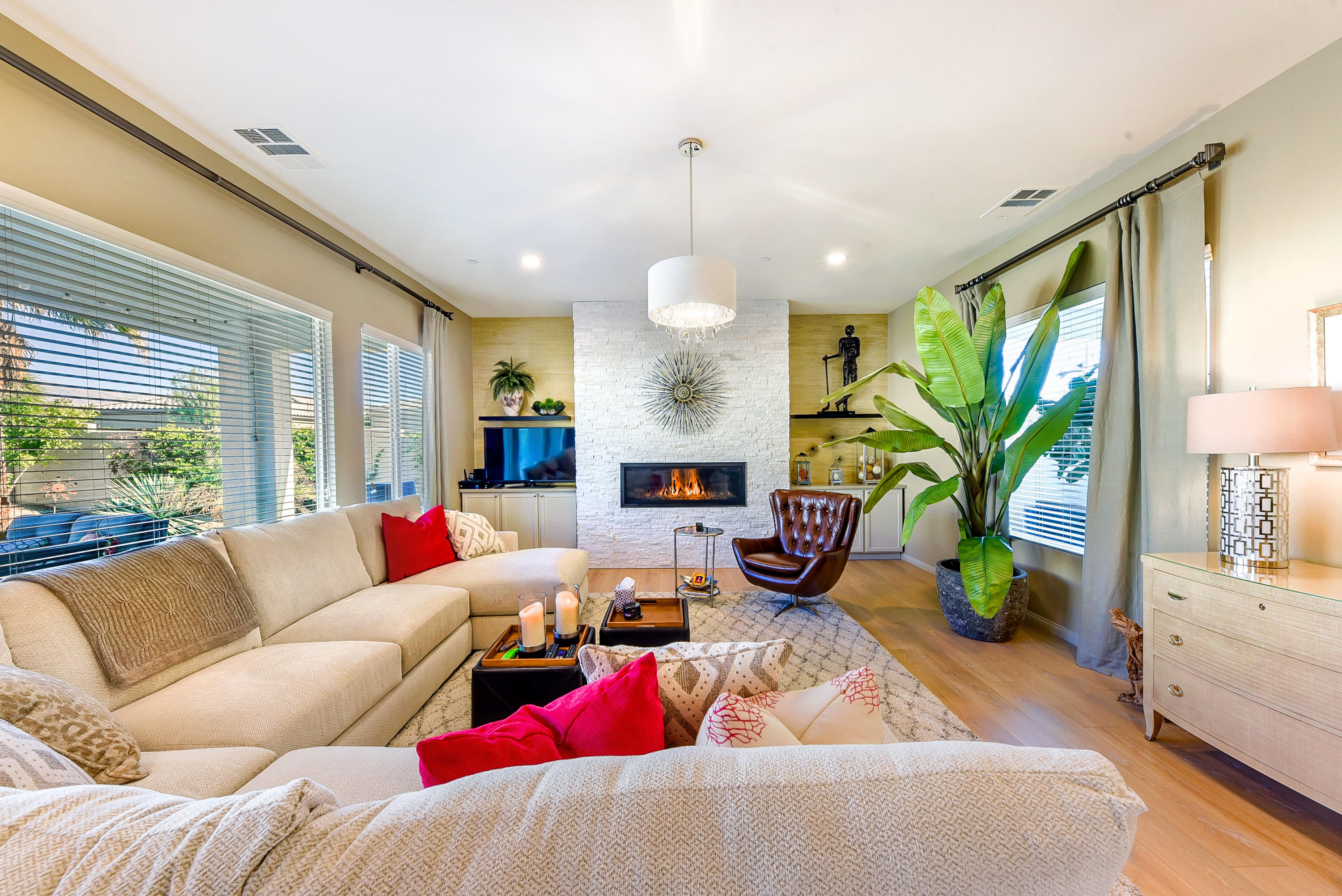 This Californian plan was built on a huge 9,148 SF privacy lot to 2789 SF (EST.) in 2012. It features three bedrooms, 4 baths, a large den, a retreat, a sauna and an attached 2 car garage with real A/C. The seller, who is a designer, purchased this home in March 2017 and promptly remodeled it into an incredible permanent winter home. Things have changed and now this like new 2021 modernized home is available. The carpet in the great room, den, 3 bedrooms and closets were replaced with a high quality German engineered wood laminate flooring that carries a 35 year warranty. The beautiful floors look and feel like real wood yet they are even better. A rectangular modern gas fireplace was placed in the center of the great room where it was enclosed, floor to ceiling, in a white stack stone surround. Custom cabinets were installed on either side to finish the room. Enhancements include a cut glass entry door, extensive use of accent wall cover, the entire home & all doors painted, pendent lights added, a new kitchen back splash, upscale light fixtures, window cover, ceiling fans: all blended with loving care and an enormous expense to a gorgeous totally finished look and feel. Everything perfect to please the most discriminating buyer who appreciates quality and loves perfection!