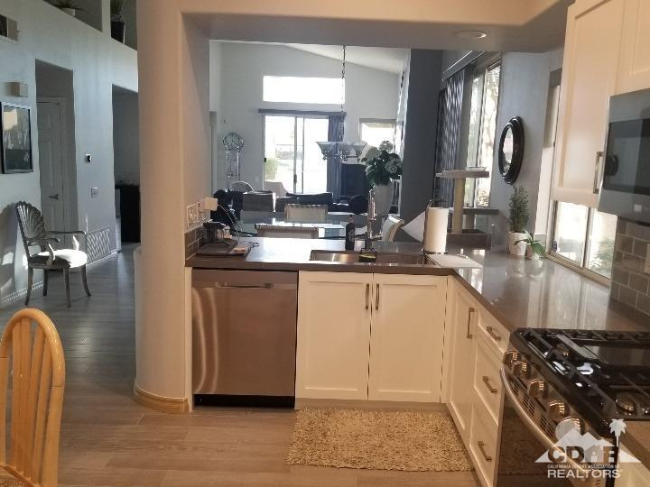 Beautifully renovated and upgraded home, with superb west-facing views.  Exterior was fully painted in 2019, with new extended patios, landscaping and lighting.  Spacious remodeled kitchen with new quality white cabinets and SS appliances, reconfigured for more space! Enjoy two sinks in the kitchen and an extra fridge for drinks.  Built in ''bar'' in the living room features two wine fridges.  Enjoy gorgeous views of the Vista 2 fairway and San Jacinto mountains through all new west-facing windows, or move outside to an entertainer's patio with multiple sitting and dining areas! The side yard has shade in summer for afternoon drinks or dinner.  The two-car garage features extra parking for a golf cart.   Don't miss this home.   The Desert Princess has an affordable 27-hole PGA Championship golf course, no Tee-time lotteries, no initiation fees, rated among the best in the valley by GOLF DIGEST. This quiet community is away from the noise yet minutes from everything that is in Palm Springs: restaurants, shopping, casinos, an international airport, the Tramway, Art Museum, Theaters, and the Street Fair. The Desert Princess also features 34-swimming pools; 10-tennis courts; a state-of-the-art fitness center and a very active country club social scene! Land lease expires 2069 and monthly ground rent is $146.27.