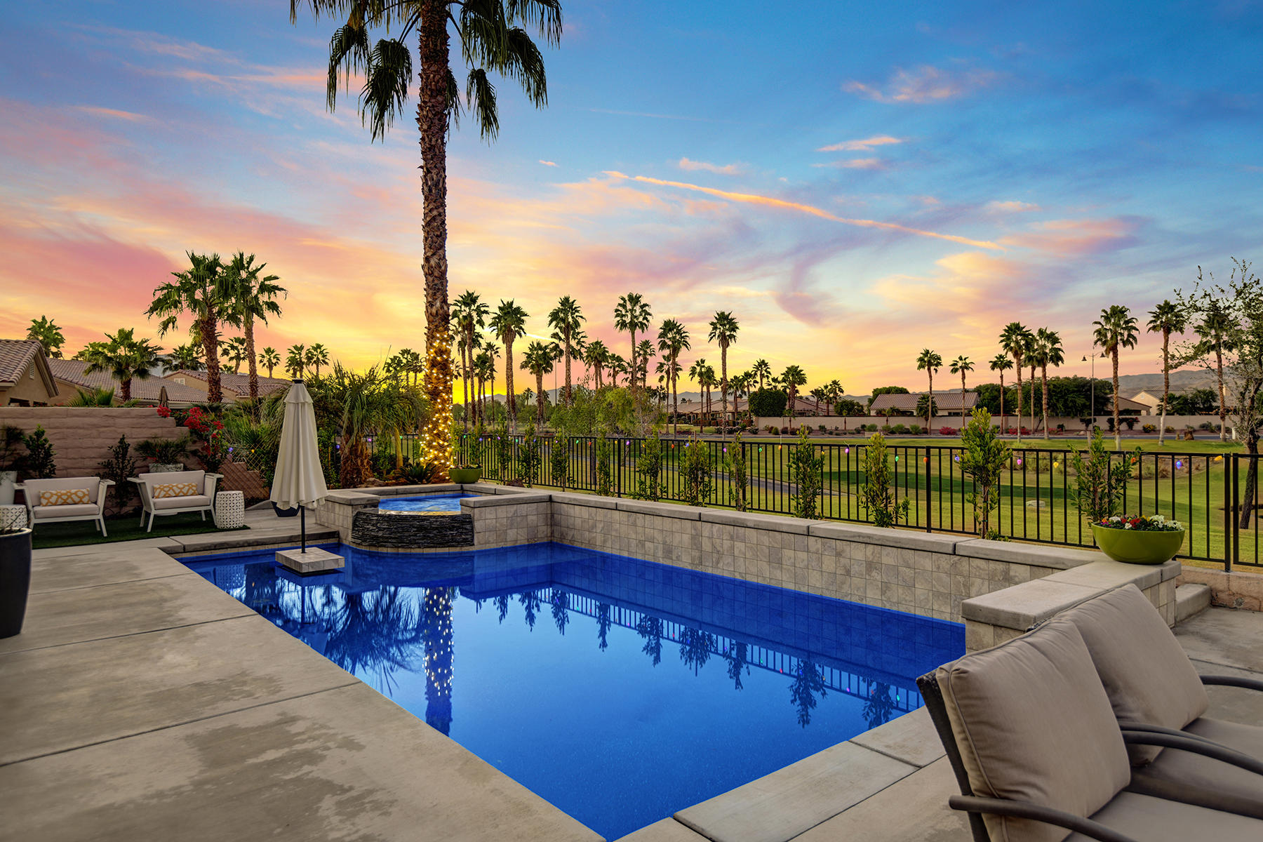 EYE CANDY every day from Great Room, across PRIVATE POOL, over LAKE on FAIRWAY, to backdrop of Little San Bernardino MOUNTAINS. Entertainers allure is BBQ Island, covered patio, large tanning shelf & table in pool, raised spa spillover plus water streams.  Popular Avalino Plan, built to 1,763 SF (EST.) in 2006. Custom upgrades include tile living areas, wood laminate in office, designer paint, plantation shutters, custom window coverings, fans, recessed lighting and more! Great room open to kitchen, granite countertops, quality cabinets with pulls & lower roll-out shelves, stainless steel appliances with gas cooktop & double ovens, plus a step-in pantry. Spacious master suite features dual vanities, oval tub, glass shower, and large closet. So much more to see and enjoy!  Move-in Ready!  Low HOA!  Ownership at Sun City Shadow Hills, active Adult Community 55+. Residents have access to a variety of clubs, activities, tennis, two golf courses (at a nominal fee), fitness classes, state-of-the-art fitness equipment, resort-like pools and spas, two clubhouses, dining & dog parks.