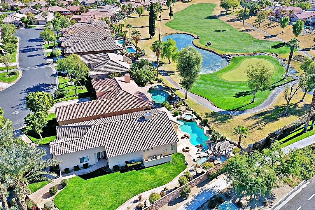 REDUCED $50, 000 TO SELL NOW! ONE of a KIND beautiful Resort Retreat to come and bask in the RESORT SUN w/beautiful views of fairway, lake, waterfalls, and pool/spa. Wether you use as winter retreat or a full time home, this MANHATTAN PLAN is a jewel of a place to enjoy an awesome time w/family and friends.  Sitting on over 10K sq ft lot at the end of a CUL-DE-SAC, it features 3 bedroom, 3 bath (One bedroom is attached casita w/exit to exterior and to main home) 2 car garage with opener.   It also features a resort style pool and spa and large cascading waterfall on the property, overlooking the SIGNATURE HOLE/green, lake, fairway, and additional waterfall and creek on golf course. This property has  one of, if not thee most dramatic views.    It offers a very open floor plan from the kitchen to the great room and offers views of the exterior from the great room and master bedroom. It has high vaulted ceilings, and TILE floors in all areas except bedrooms and closets. NEW Exterior Paint, And all cabinets thru-out the home have been painted professionally (white satin), and the interior custom paint and decor are Santa Fe colors and motif. This home is offered furnished, as per inventory list.   Indian Springs is centrally located near lots of shopping, fine and middle of the road restaurants. It's near many PGA a style golf courses, and major event sites for professional tennis, golf, music and other major events. Come and join us as we live where presidents & the stars play