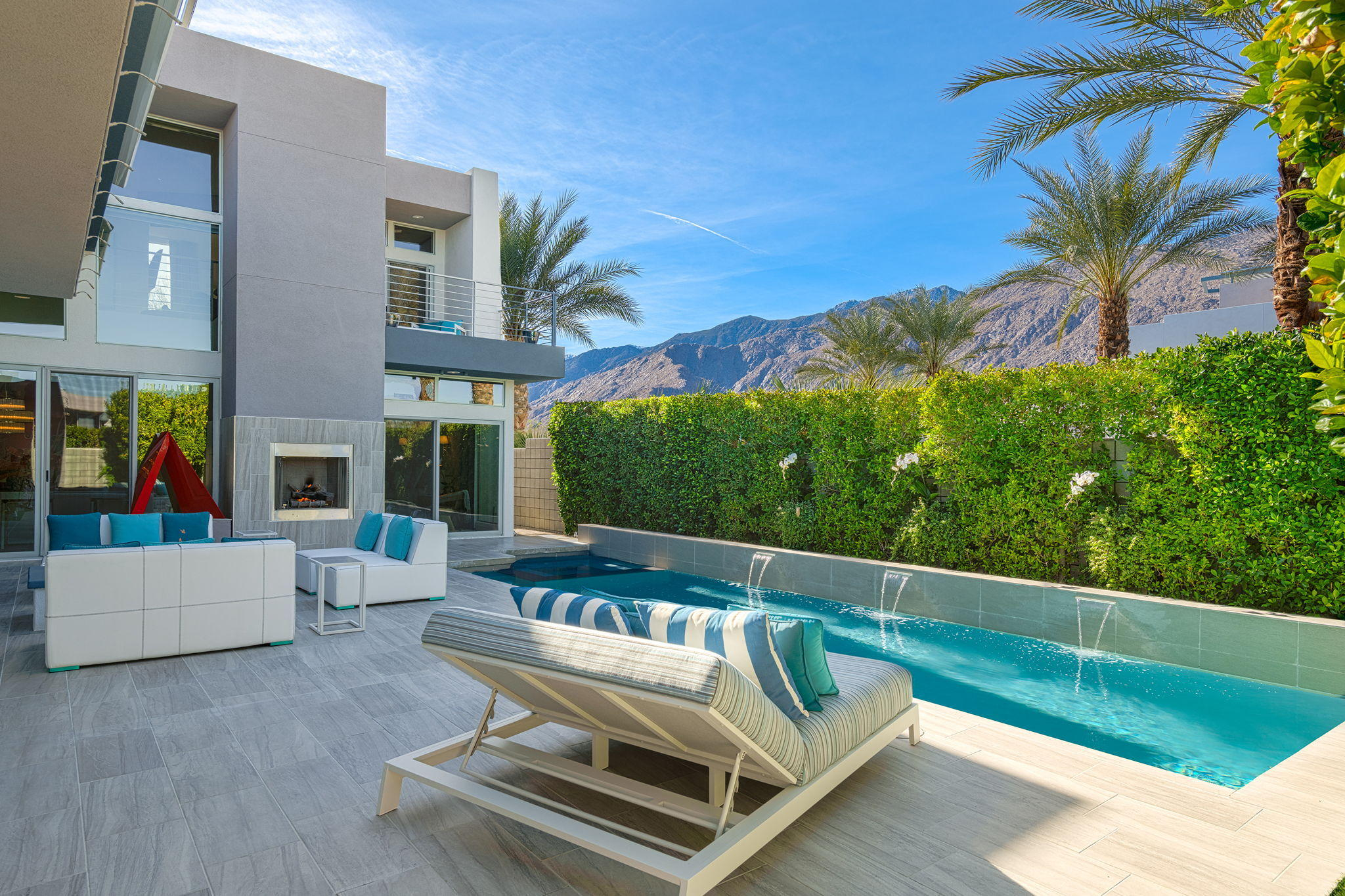 Welcome to what could be James Bond's secret hideaway! In the heart of Palm Springs at SOL, this custom floor plan was blown up and expanded wherever possible.  From the Savant® smart system to the owned solar with battery backup this property is highly intelligent as well as efficient.   With custom details throughout, this home is extra in every way imaginable including high-end appliances in the kitchen, an air-conditioned garage, laundry in the master closet and whole house misting system.  Enjoy the sweeping unobstructed views of Palm Springs from the custom rooftop deck with fire pit, wet bar and powder room for the ultimate in entertaining. Incredible flex space on 2nd floor to be what you need as an office, leisure or workout area.  Make this ultimate SOL home your own personal getaway today.