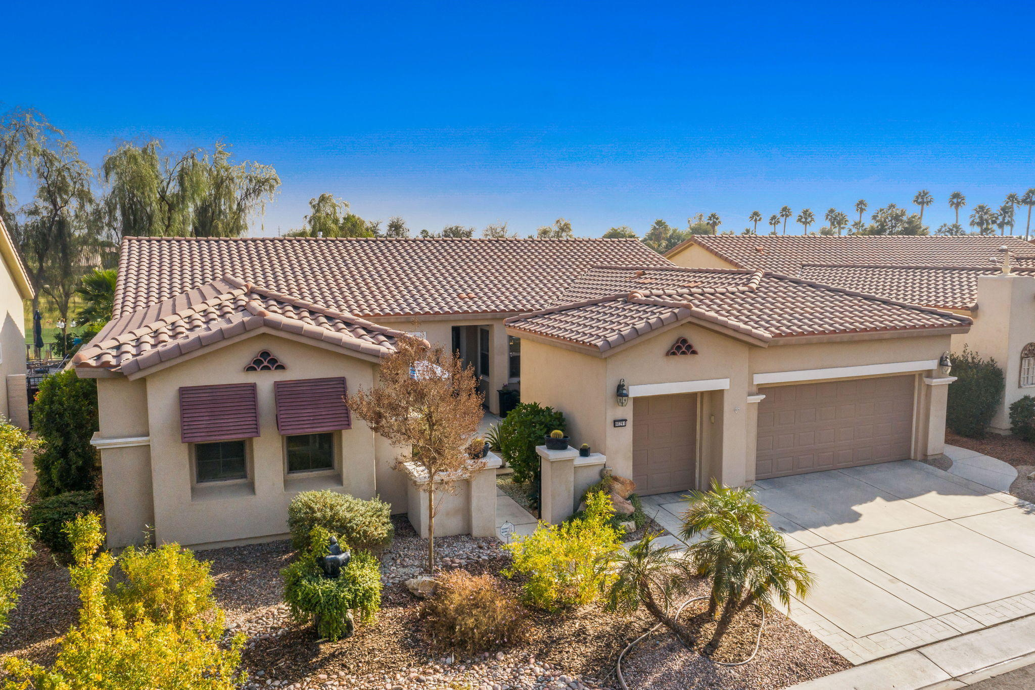 Rare Opportunity at Sun City Shadow Hills! This updated San Miguel has a one-of-a-kind modified floor plan. Removing 1 wall opened up + united the living areas making one of the most stunning great rooms you'll find! Your eye will catch all the fresh designer details incl. new floor-to-ceiling stacked limestone accent wall, new flooring, paint + window coverings. Updated gourmet kitchen w/ new gas appliances, stainless farm sink, faucet + hood. Refinished cabinetry, slab granite countertops, island + breakfast bar + eating area ideal for entertaining. Virtually NEW pool (2 years old) complete w/ waterfall + sunken tanning deck, perfect for enjoying the sunshine and gorgeous golf course + mountain views. Live like you're on vacation every day in the spacious Owner's Suite! Luxurious 5 piece bathroom w/ jetted tub + massive walk-in closet, golf course views + direct access to partially covered rear patio + pool area. A long travertine tiled hallway leads you to the separate Guest Suite featuring a private exterior entrance + full bathroom. Other features include: Den/Office, courtyard patio, 2 car garage + golf car bay, 1/2 bathroom for guests and laundry room. Ideal Phase1 location near the main entrance w/ a prime elevated golf course lot on the 11th fairway of the Shadow Hills South Course. Only 2 blocks from the Shadow's Restaurant (+Bar), the Troon Pro Shop + driving range, 1 block to the dog park. HOA amenities incl. 2 club houses, pools, bocce ball, tennis courts + more!