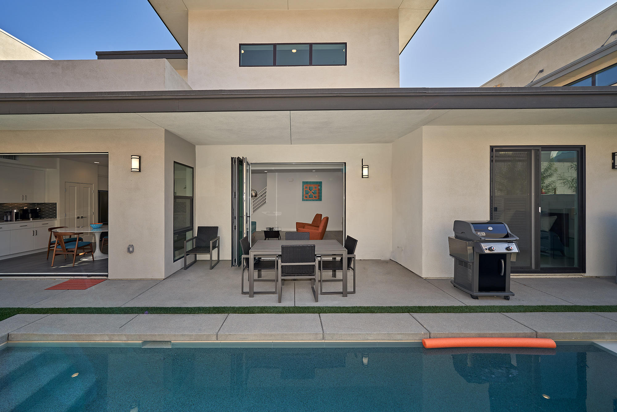 This beautiful 2019 Vibe townhome is the stand alone plan with no adjoining walls!  This sophisticated and barely lived in home has 2 primary suites, a home office and a separate media room/den! One primary suite is on the first floor while the other 2nd primary suite is upstairs.  The backyard has its own pool and spa and dining and lounging area.  This pool is also larger than many of the others in the development. The home is loaded with upgrades including solar! The private attached two car garage includes a charger for an electric car.  Perfectly situated in central Palm Springs in close proximity to shopping, restaurants and entertainment!