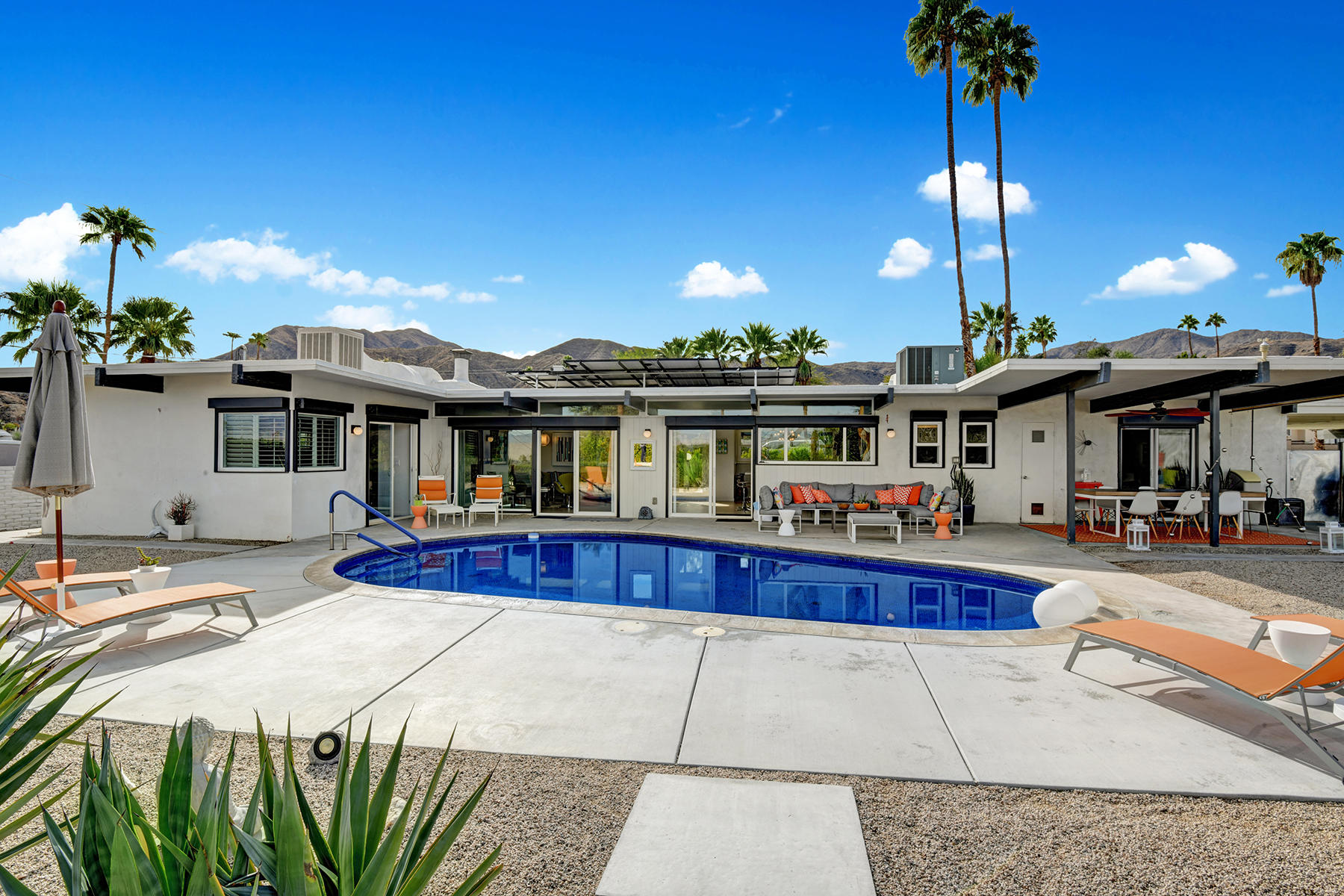 Welcome to 68386 Treasure Trail. Located in the Cathedral City Cove. Unlike any area of the desert The Cove offers a tranquil way of life. This peaceful slice of the desert is accentuated from the moment you pull up to this home. Step through the ficus hedge at the perimeter of the property and you are immediately greeted by the Mid-Century architecture so many seek in their desert home. Clerestory windows grace the front of the home along with the immediately striking post and beam construction. Once inside the home your gaze goes directly to the backyard and the readily available desert vistas. This wall of windows that allows for the indoor outdoor lifestyle wraps around the entire back of the home. Step outside into the backyard and big views of Mt. San Jacinto open up immediately. Updated flooring, and finishes reach every inch of this home. Beyond that you have improved infrastructure with updated plumbing and electrical. You'll find massive savings on heating and cooling bills with every window and door having been replaced. To top it off you've got solar on the home bringing energy efficiency to a level expected yet not often found in the desert. This home is being offered with furniture available. Be sure to check out the 3-D tour. Soon you can be floating in the pool, sitting by the firepit, or going on strolls through the neighborhood. Call today to arrange for your private showing.