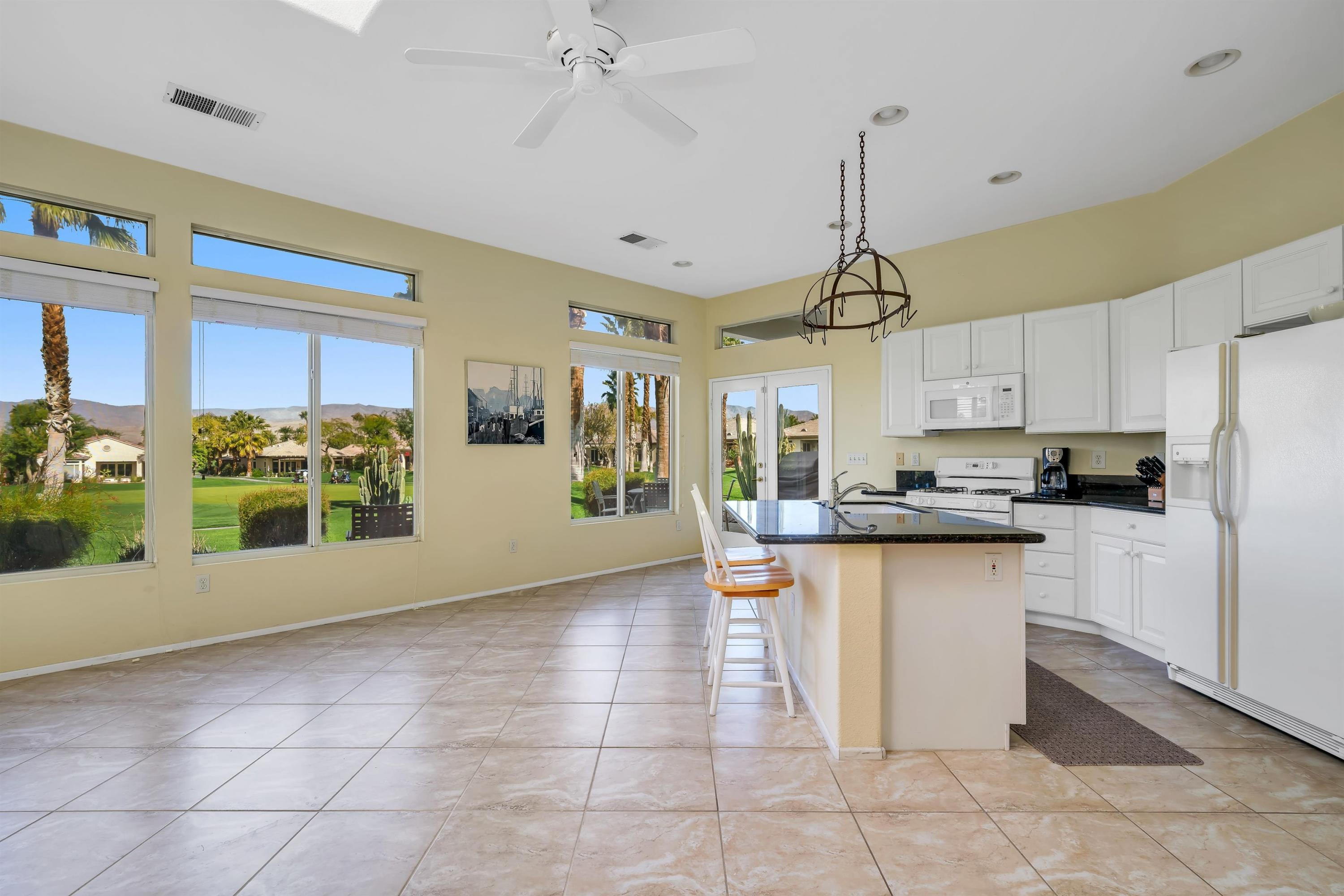 This wonderful home in pristine condition is located in the exclusive 55+ community of Heritage Palms Country Club, overlooking the 3rd fairway, with mountain views. Open floor plan includes 2 bedrooms, 2 baths. Master bedroom has his/hers walk-in closets. Community has Guarded gate entrance, Club house, paddle ball, tennis, pool + indoor pool, spa, gym w/steam room, billiards, cards, library, Dinning, bar. All inclusive plus cable with HBO and internet. MUST See.