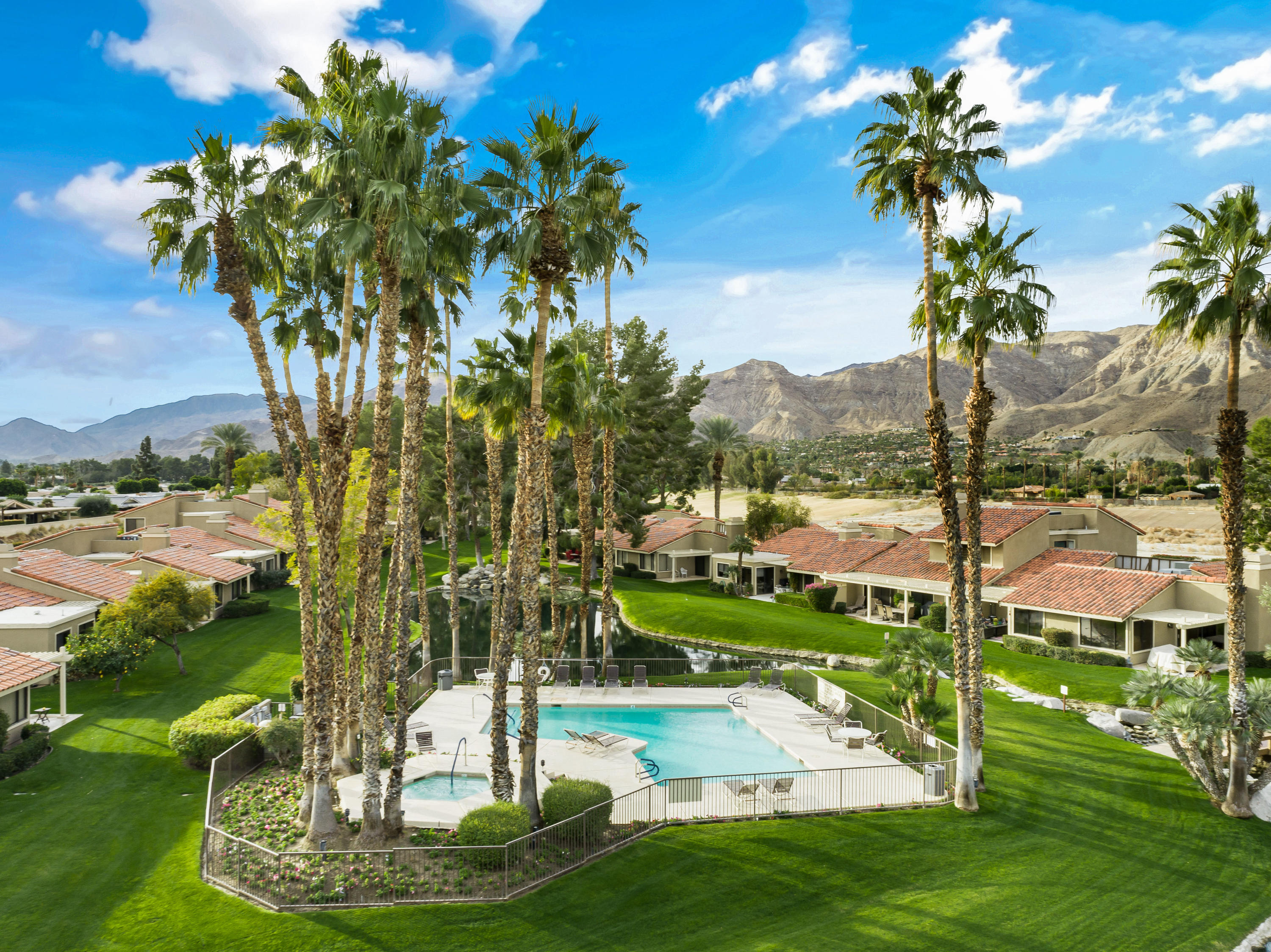 Immaculate Rancho Mirage Racquet Club condo with majestic mountain & spectacular river views. Enter this serene single story residence, through the wrought iron gate, which boasts 2079sqft. of updated interior living space, including 3 BD/3 BA, vaulted wood-beam ceilings, recessed lighting, upgraded plank flooring throughout, and inviting gas fireplace, with raised hearth. Formal dining room is adjacent to the entertainer's wet bar and Chef's kitchen featuring stainless steel appliances, custom hood, built-in ovens, slab granite countertops, breakfast bar and ample cabinetry. Dual guest accommodations afford comfort and privacy for all visiting friends/family, and both have en suite baths with large walk-in tiled showers and skylight. The Master Retreat is spacious with gorgeous rear views and attached luxury bath with large tiled (w/accent tiles) shower/tub. Enjoy relaxing times on your rear patio while taking in the sound of flowing river water, and peering out to the mountain vistas. The community features 5 pools, 9 tennis & pickle ball courts,1 Racquetball court, putting green, a gym, lakes, waterfalls, free-flowing streams. Close to all shopping and medical facilities.