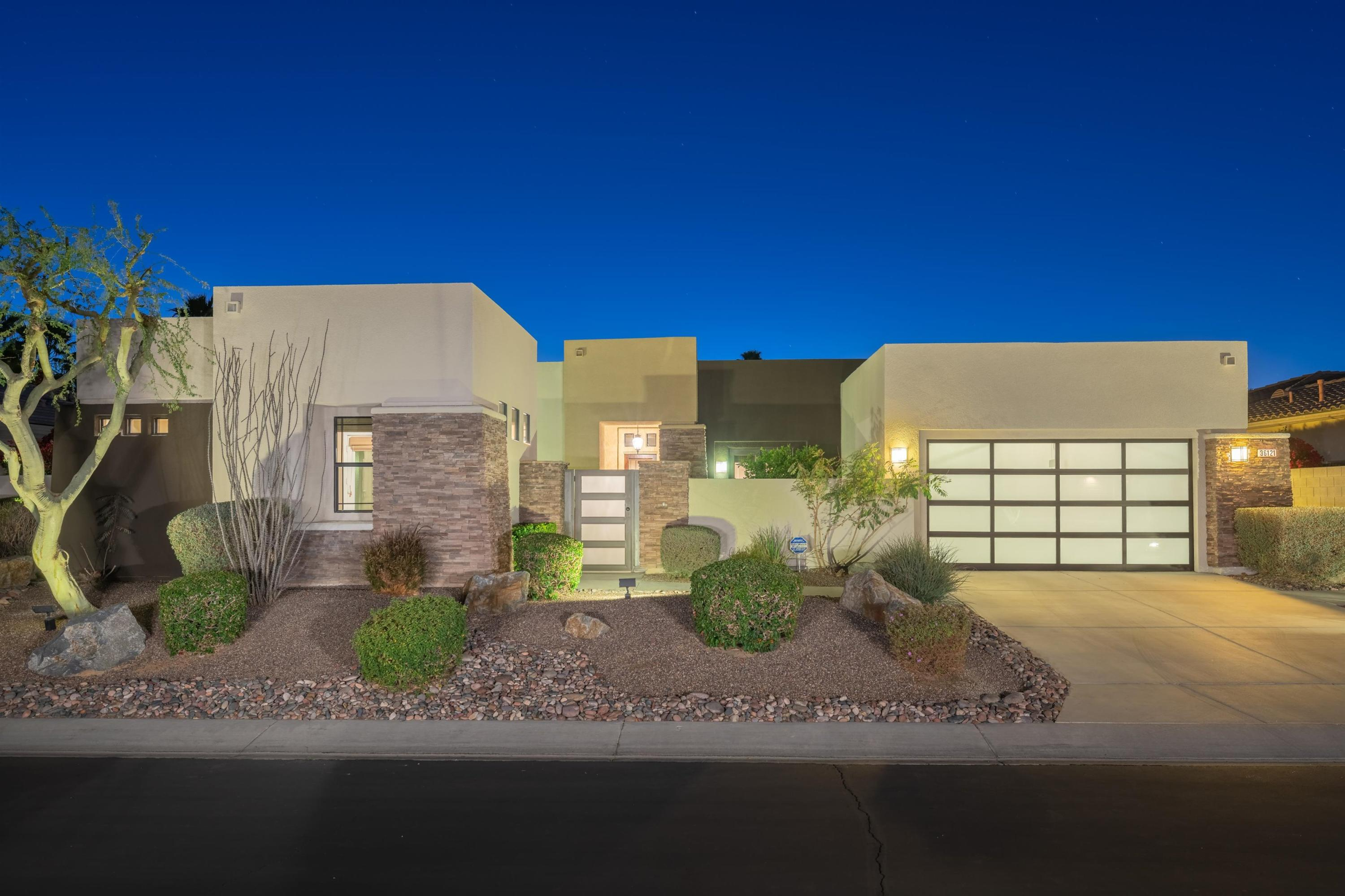 Exceptional design, comfort, and location makes this the perfect dream home.  This home has everything you could want and more.  A rare contemporary Plan 2 (Chagall model) offering 2,389 sq ft is now on the market in Montage at Mission Hills.  The home has custom interior design by Jerry Delmonico.  The exterior of the home was recently repainted.  There is a new sleek glass panel garage door, a new glass panel/metal front gate, and a new front entry glass door.  This home is perfect for entertaining, offering a great room with surround sound, gas fireplace, wet bar with wine refrigerator, a designated dining area and a large kitchen featuring a stainless steel 5 burner gas cooktop, double electric ovens, microwave, dishwasher and a 36 inch French door refrigerator/freezer.  There are 3 bedrooms (including a detached casita), plus a den/office with French doors opening onto an enclosed, front courtyard with outdoor fireplace.  The master bedroom with a spacious walk-in closet has amazing mountain views.  From the master bedroom French doors open onto a covered loggia with more western mountain views from the back yard.  There are 3 additional bathrooms (including a powder room).  Outdoors you will find a gilling island with gas BBQ, a mini bar refrigerator, fire pit, 40 foot salt water swimming pool with water features and a raised 10 person spa with a waterfall.  This home has been impeccably maintained and it shows.  HOA dues only $260/mo and includes MHCC membership.