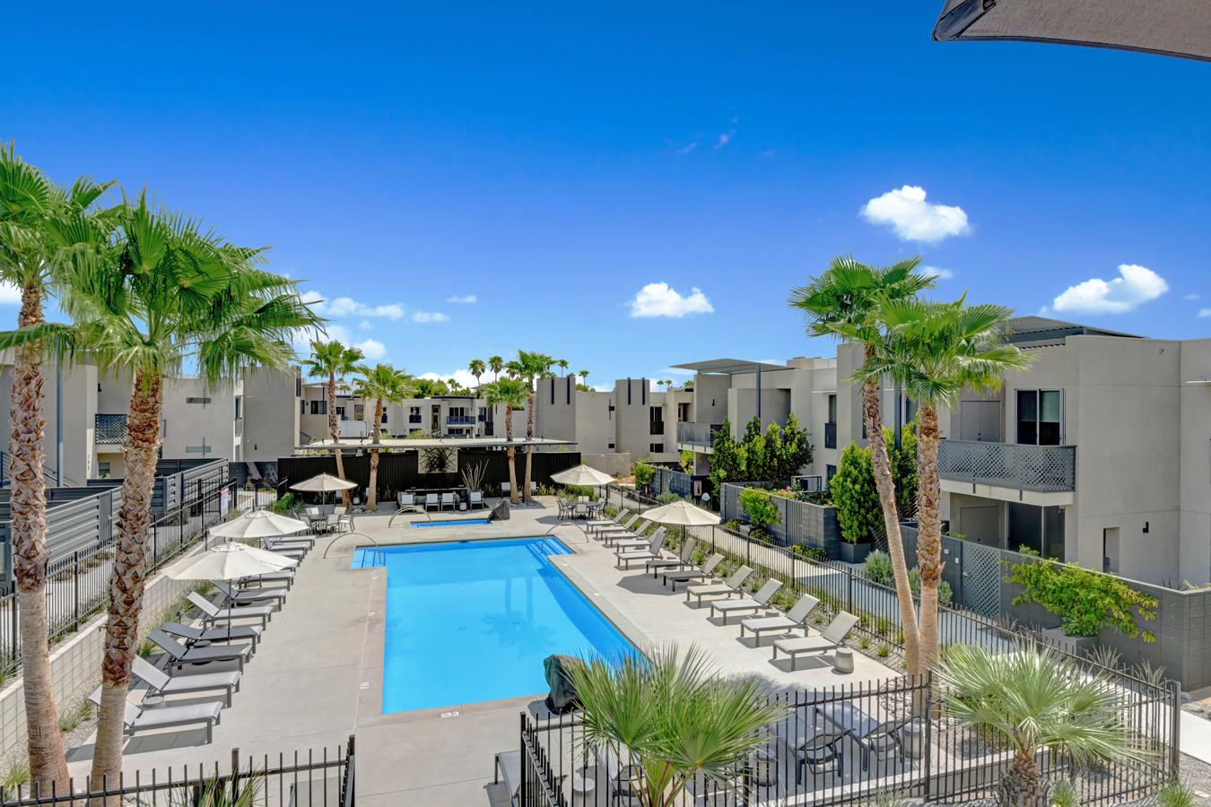 Looking for the perfect Palm Springs getaway? Highly upgraded condominium within the gates of 64@theRiv, located in the best location, and move-in ready! Featuring 2 Bedrooms, 2.5 Bathroom 1501 Sq. Ft. of living space.  Located Pool-side, this open concept home features a great-room & social gourmet kitchen, 9' ceilings, 8' sliders & clerestory window, all flowing out to the covered lanai overlooking the resort style pool area.  Upgraded luxe fit & finish details include 24x24 designer tiled flooring, quartz counter-tops, Fisher & Paykel appliances, wine refrigerator, Grohe & Kohler fixture, custom motorized window coverings, art lighting package,  Cocoon® fireplace, Maytag 5500 Series Washer & Dryer, and private owners storage closet.  Green/Energy efficiencies feature low-E glass, LED lighting, tankless water heater, 3 kW owned Solar & more! This Gated Community features a resort-style pool/spa, fire-pit conversation area, outdoor BBQ, Car-charging stations, dog park and stunning mountain views...Palm Springs Living at its Best!