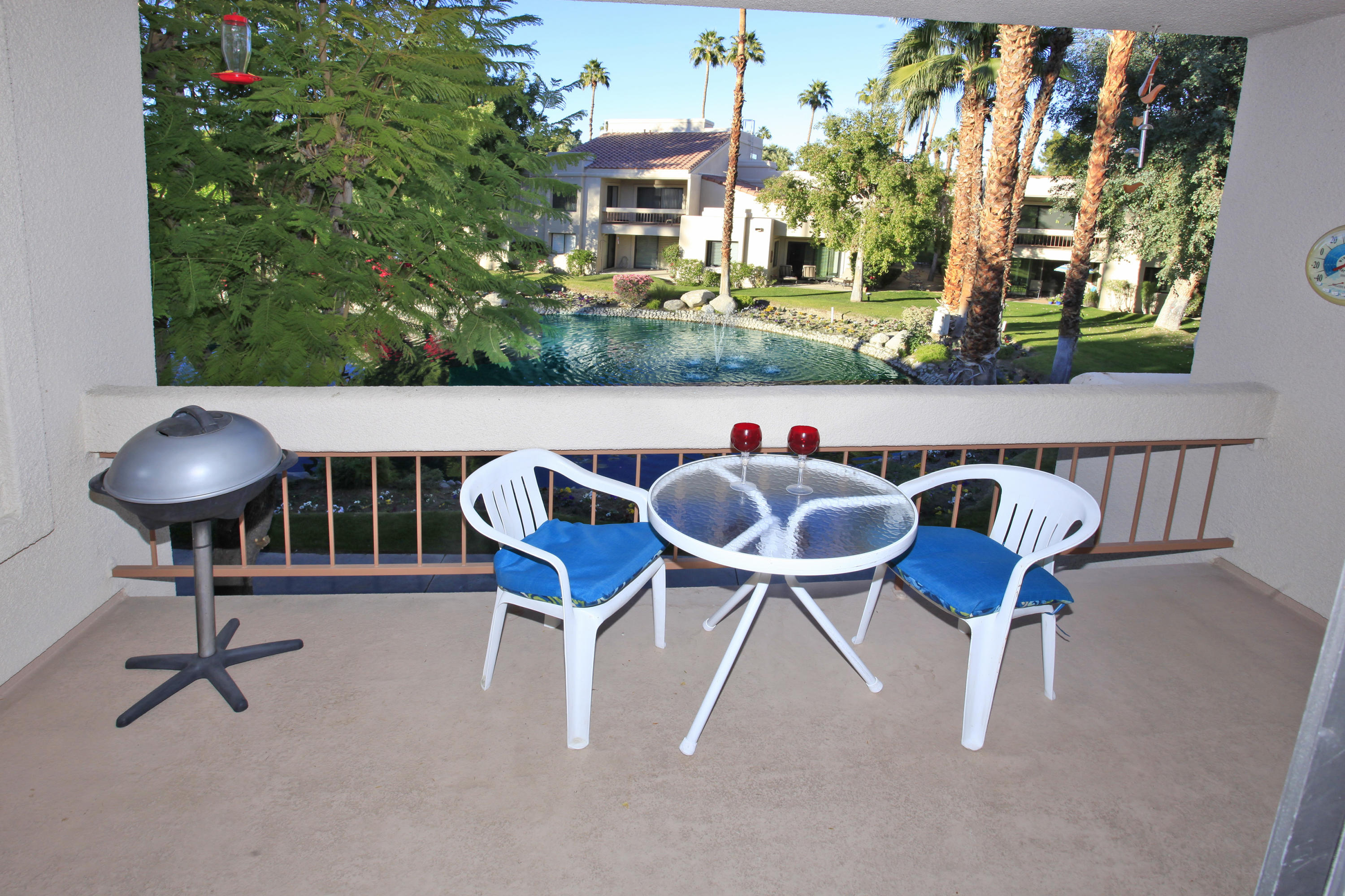 Large 2 bedroom 2 bath with lagoon views from living room and dining room. Tile floor thru out unit.. Enjoy all amenities this lushly-landscaped gated community has to offer. You will be amazed with sights and sounds of streams and waterfalls, lagoons, 5 pools and spas. The newly refurbished club house includes exercise room and saunas. Soak in the views of the mountains or enjoy the walking trails around the complex or tennis courts. Public golf course is just across the street. Canyon Shores has their own onsite management. Perfect for a Vacation Home or Investment property. Located near shopping, restaurants, airport, Highway 111 and nestled between Palm Springs and Palm Desert. Makes a perfect seasonal rental or year round home. Only 7 days required for rentals. Land you own - no lease and FHA approved!