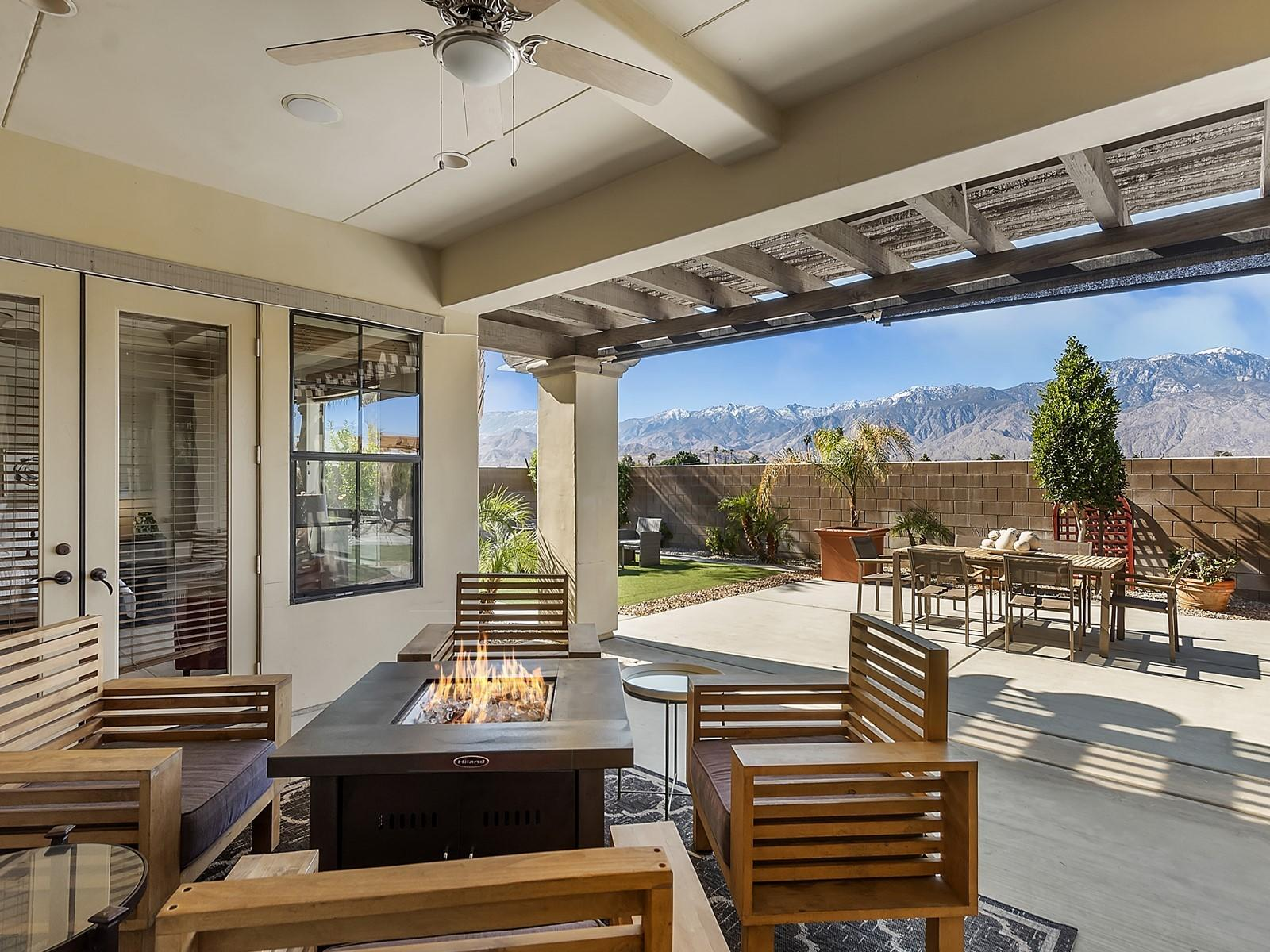 Largest model at Campanile with upgrades galore from custom tiled floors to lighting to sound system. Open airy floor plan, awesome mountain views. Master suite and attached casita on first level. 2 guest bedrooms with ''jack'n jill'' bath and den/media loft area. Formal dining, fabulous chef's kitchen with center island and breakfast nook. 2 car attached garage on side and one car garage adjacent to casita.  The backyard is beautifully appointed with gazebo, covered patio and artificial turf.  Community features include resort sized pool, spa, gym, club house and LOW HOAs. Great central location to shopping, restaurants, I-10 access , golf and casinos.