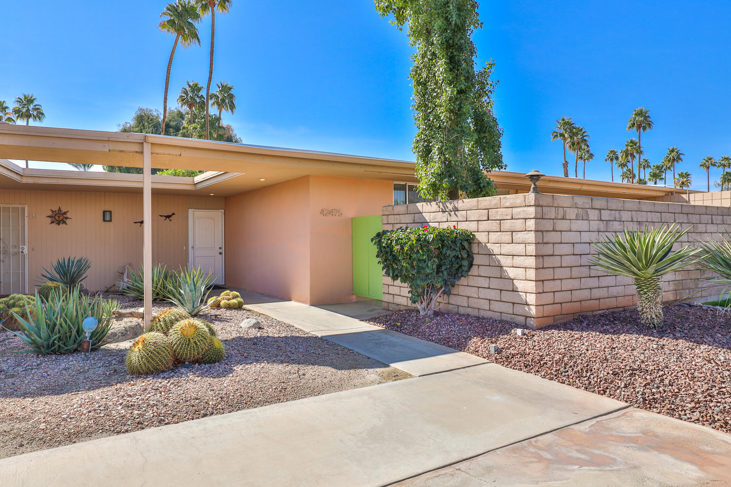 Don't miss your chance to own a Donald Wexler built Mid-Century Modern in The Colonies located just off of one of the finest 27 hole championship golf courses in the Valley with Southern exposure! This spacious condo has a wall of windows that overlook the pool, greenbelt and offer spectacular views of the double fairway golf course.  The large fireplace adds an elegant focal point to the open floor plan while both bedrooms open up to an additional private courtyard with endless mountain views.  This home features a new roof, new plumbing and a newer AC unit.  All steps away from one of 2 community pools on the property. Desert living at its best! Close proximity to all the conveniences, entertainment and shopping. Call to view today!