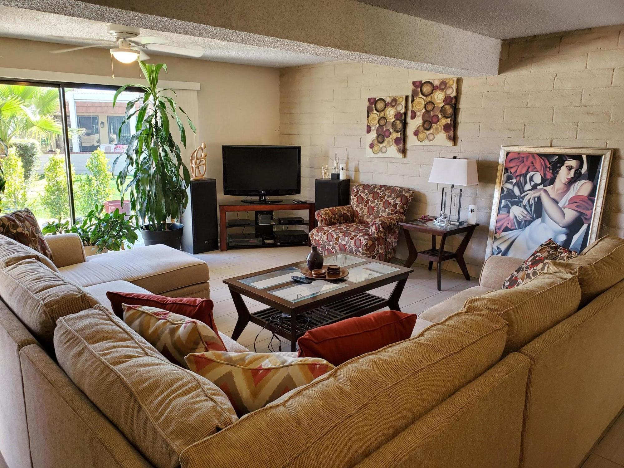 !!RECENT PRICE ADJUSTMENT!! Conveniently and centrally located inside the gated Cathedral Canyon Country Club, this beautiful Townhome style condo is very close to the new Agua Caliente Casino, to downtown Palm Springs, as well as to the East Valley cities of Rancho Mirage and Palm Desert. This home features 1,505 square feet of spacious living on two floors. The two large upstairs bedrooms, each have their own separate baths, walk-in closets, and views. On the main downstairs floor, you'll appreciate the open living room, dining area with wet bar, and the galley kitchen. A separate guest bath, and the laundry area are also located on the main floor. From the very open and light living room, enjoy the view of the grassy common area and the swimming pool. Don't hesitate on this opportunity. You will certainly appreciate and enjoy the desert resort environment, proximity to all the special venues of the desert, and all the amenities offered in the home and the community.