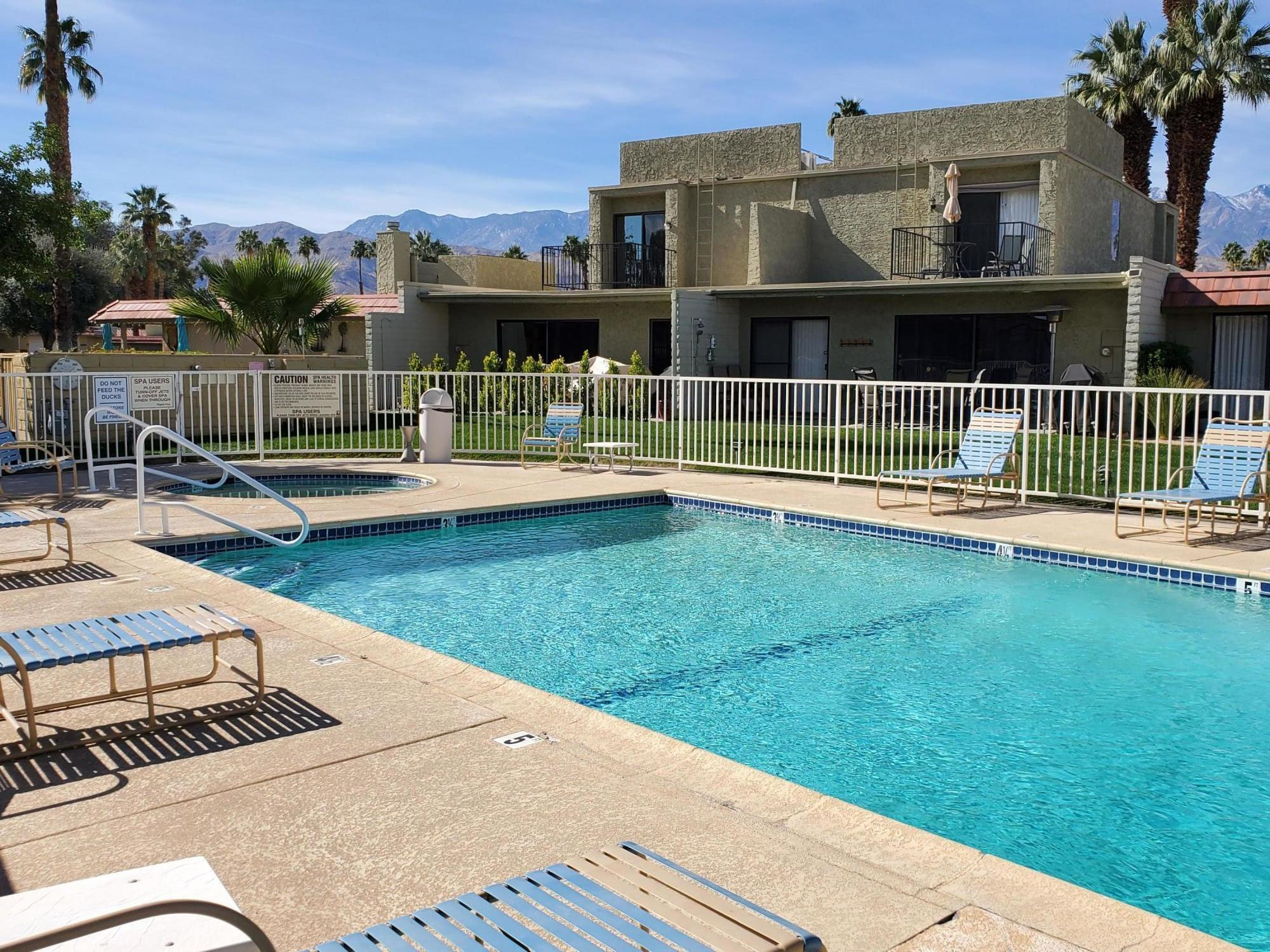 Conveniently and centrally located inside the gated Cathedral Canyon Country Club, this beautiful Townhome style condo is very close to the new Agua Caliente Casino, to downtown Palm Springs, as well as to the East Valley cities of Rancho Mirage and Palm Desert. This home features 1,505 square feet of spacious living on two floors. The two large upstairs bedrooms, each have their own separate baths, walk-in closets, and views. On the main downstairs floor, you'll appreciate the open living room, dining area with wet bar, and the galley kitchen. A separate guest bath, and the laundry area are also located on the main floor. From the very open and light living room, enjoy the view of the grassy common area and the swimming pool. Don't hesitate on this opportunity. You will certainly appreciate and enjoy the desert resort environment, proximity to all the special venues of the desert, and all the amenities offered in the home and the community.