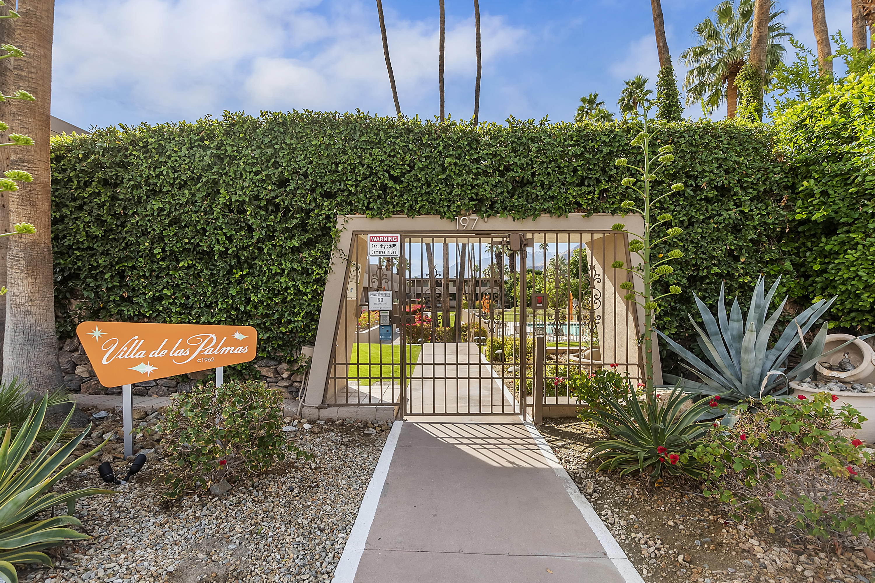 This rare condo, situated in the prestigious Old Las Palmas neighborhood of Palm Springs, has all the charmingly authentic Mid-Century-Modern feel one could want. Welcome to Villa De Las Palmas—one of Palm Springs' hidden jewels. Built in 1962, this intimate, 24-unit community reminds you a bit of the glamour of old Palm Springs. This rare end unit has three outdoor living spaces for you to enjoy and includes the best of those classic Palm Springs mountain views that everyone craves. The kitchen has views of the interior courtyard, and leads to the dining and living rooms with the original stacked stone fireplace—a Mid-Century treasure. There is plenty of storage within the two-bedroom, two-bath layout. Two additional balconies are available to enjoy that indoor outdoor lifestyle. This one-of-a-kind opportunity comes complete with underground parking and an additional exterior storage area, beautifully landscaped community grounds, and a year-round heated saltwater pool and spa.