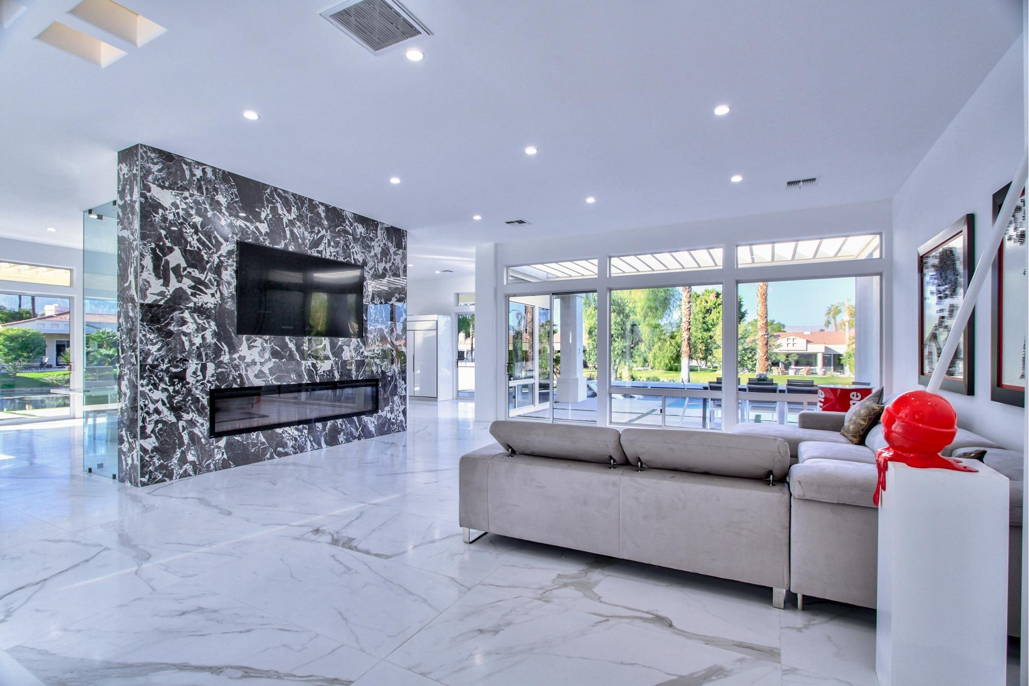 Phenomenal Modern Luxury Pool Home Reimagined In Heart Of Indian Wells. With 3,641 sq ft of beauty and perfection  this exquisite home overlooks a wrap around lake with western mountain views. 72' white porcelain tiles lace the floors of the home & walls of glass allow maximum natural light & gorgeous views from the entire house. This is a very open & flowing floor plan. The wine wall is a perfect exhibit over dining and sitting area with piano and fireplace. Spacious Master Suite with fireplace opens to pool area. The lavish master bathroom rivals the most luxurious spa with oversized walk in shower, l.e.d. lit spa & dual walk in closets.  Great separation of rooms for all 3 additional en suite bedrooms.  Casita with kitchenette. The outdoor living space is designed with day & evening entertainment in mind. Large pool with tanning deck, colored lighting & fire feature with backdrop of the lake. The outdoor kitchen and fire pit of wrap around patio overlook the western and southern mountains that surround us. Desert Horizon is a prestigious golf community with 24 hr high level security, clubhouse, gym & a very active social lifestyle. We are located minutes from world famous El Paseo Drive and all of it's wonderful shopping and dining. Don't miss this one! Call me today for a private showing.