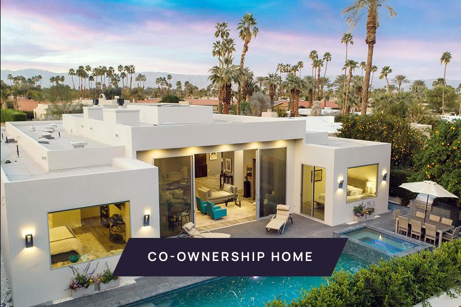 New co-ownership opportunity: Own ⅛ of this professionally managed, turnkey home.   Even if you don't play golf, this Coachella Valley home scores a hole in one. The contemporary masterpiece is located on historic Indian Wells Country Club, the original location of the famous Bob Hope Classic golf tournament.  The open floor plan brings dining and multiple entertaining areas together, all with views of the inviting pool, one of two fireplaces and mountains beyond. A unique, round kitchen features intersecting round islands, gleaming custom cabinetry and curved breakfast bar. Off the kitchen is a more intimate dining space complete with wine fridge.  The home has four en-suite bedrooms, including two tasteful master suites that feel like a five-star resort — one tub wall even has a small gas fireplace to enhance the spa-like experience.  The resort feel continues outside, with the swimming and spa pools surrounded by mature landscaping and hedge, giving the home true privacy from the adjoining golf course. The home also includes an attached casita with its own entrance, a bedroom, bath, kitchen and laundry, making it perfect for guests. Prior to closing, the home will be professionally designed with new furniture and decor.