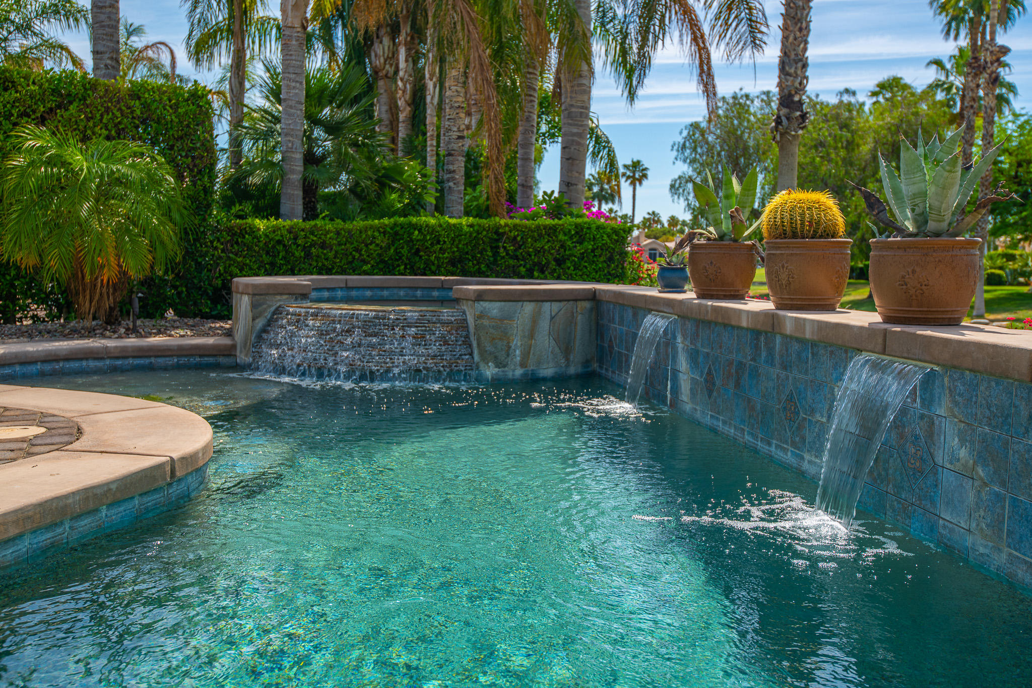 LAKEFRONT POOL VILLA ON FEE LAND!  One of the most desired locations within Desert Princess Palm Springs.  Your own private pool and spa with lake frontage and custom cobblestone patio. Located on a cul-de-sac with wide open grass area behind your yard.  Den currently used as 3rd BR.  Absolutely stunning!  Well cared for and turnkey ready to move in, or use for vacation rental income at $5500 per month in season.  Also eligible for a short term vacation rental permit (STVR).  Contact the City of Cathedral City for more details.  Incredible pool deck with golf course view.  HOA includes Country Club membership, tennis, spa, fitness center, racquetball and more. 27 holes of PGA championship golf.  Centrally located between downtown Palm Springs, Palm Desert and under 2 hours from anywhere in Southern California.  Virtual Showings via Zoom or Facebook Live, or come by in person for a showing.